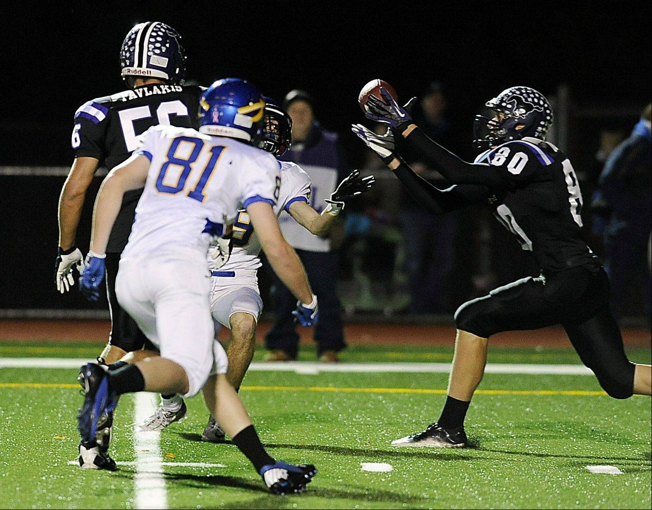 Matt Dolan, here making an interception against Lake Forest in last fall�s Class 6A playoffs, is one of many battle-tested players back in action for Rolling Meadows.