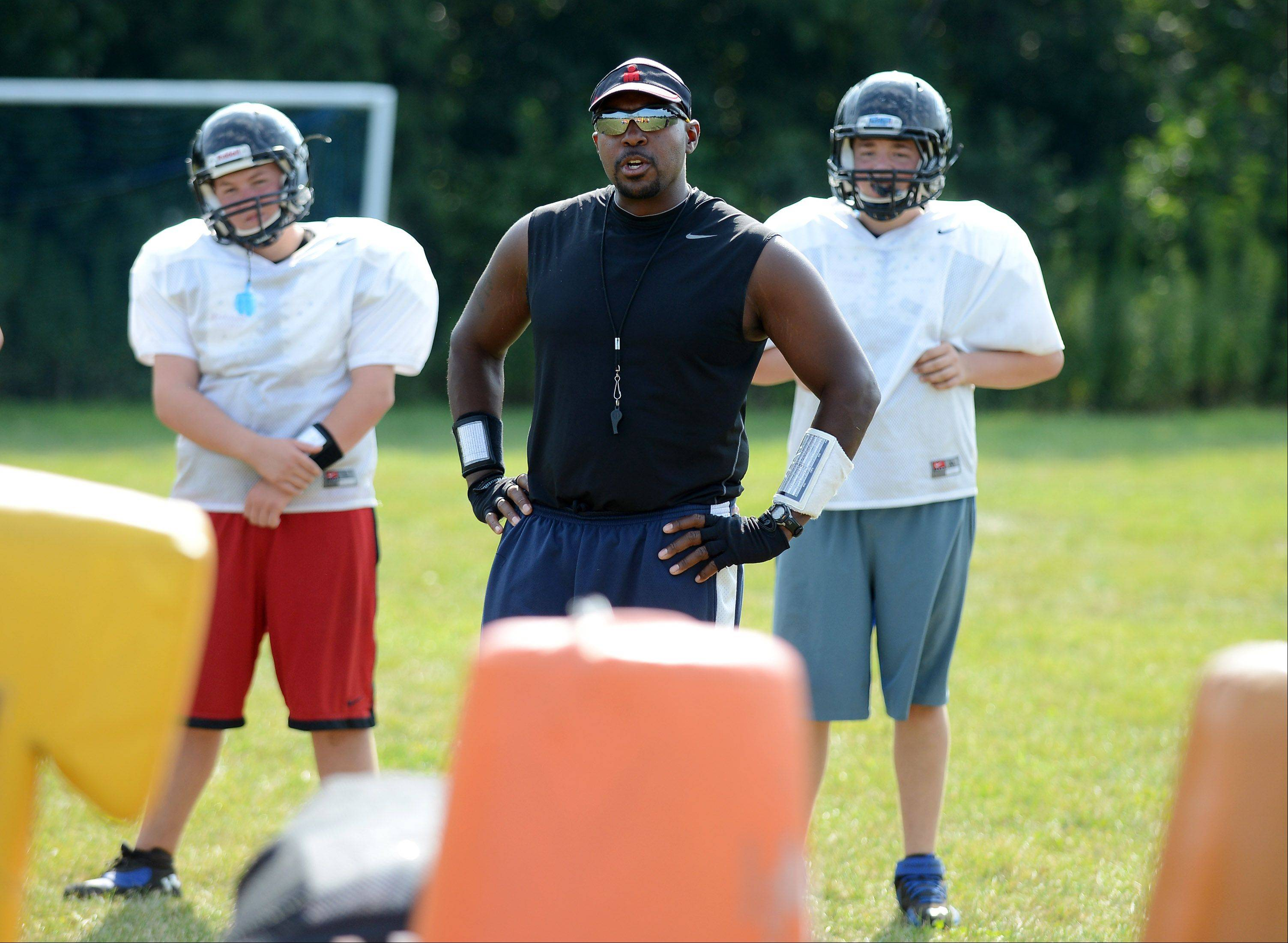 Coach John Davis leads Westminster Christian�s first varsity team at practice in Elgin.