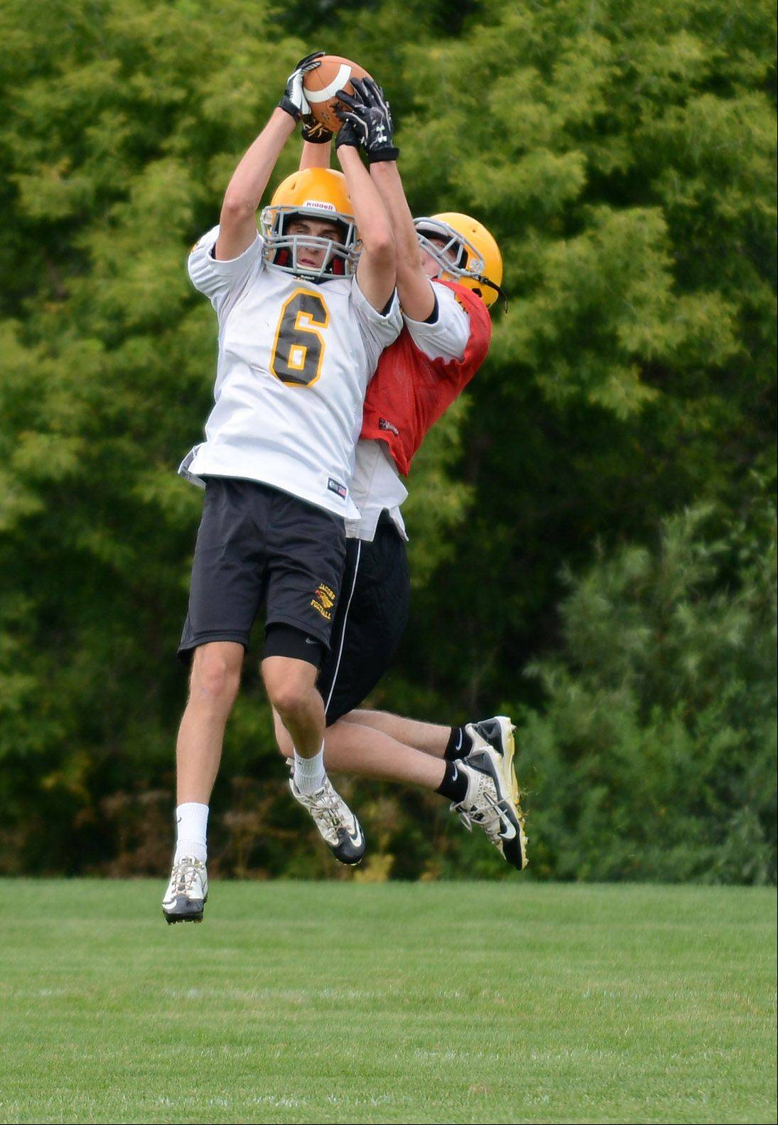 Ryan Sargent nabs an interception during a Jacobs practice.