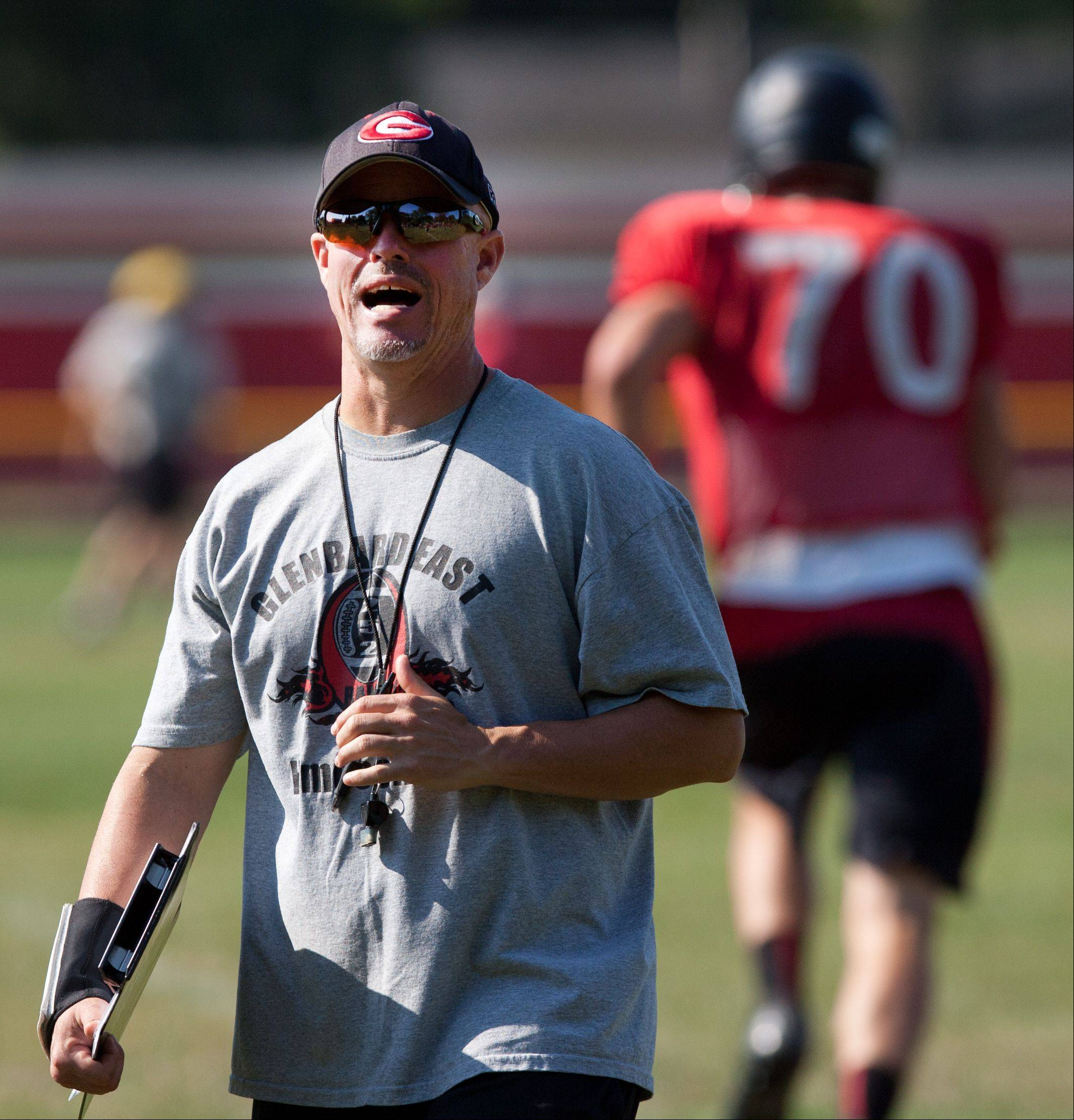 Glenbard East head football coach John Walters monitors practice.
