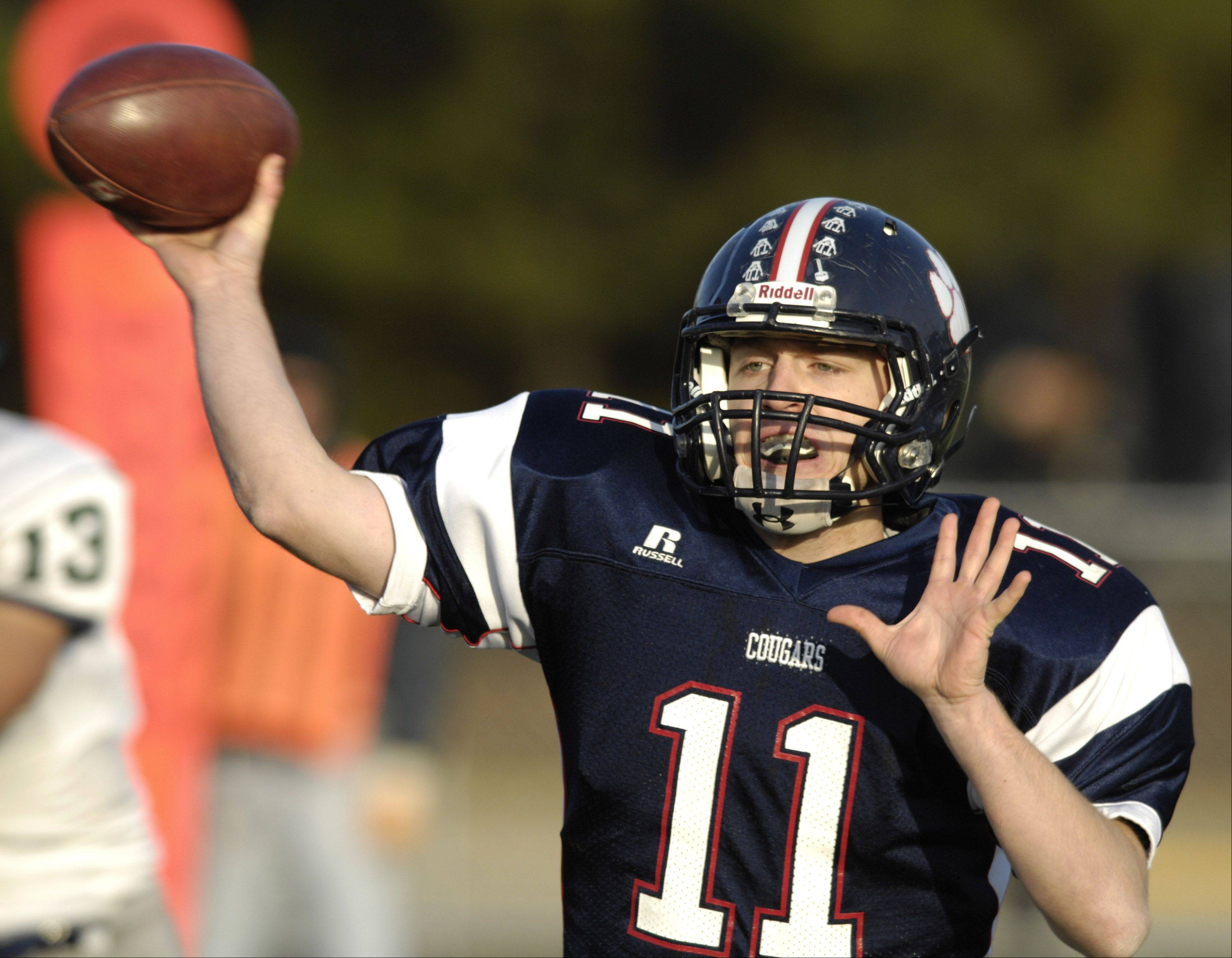 The return of skilled players such as quarterback Danny Modelski, here tossing a passing during last year�s playoff game against New Trier, bodes well for Conant.