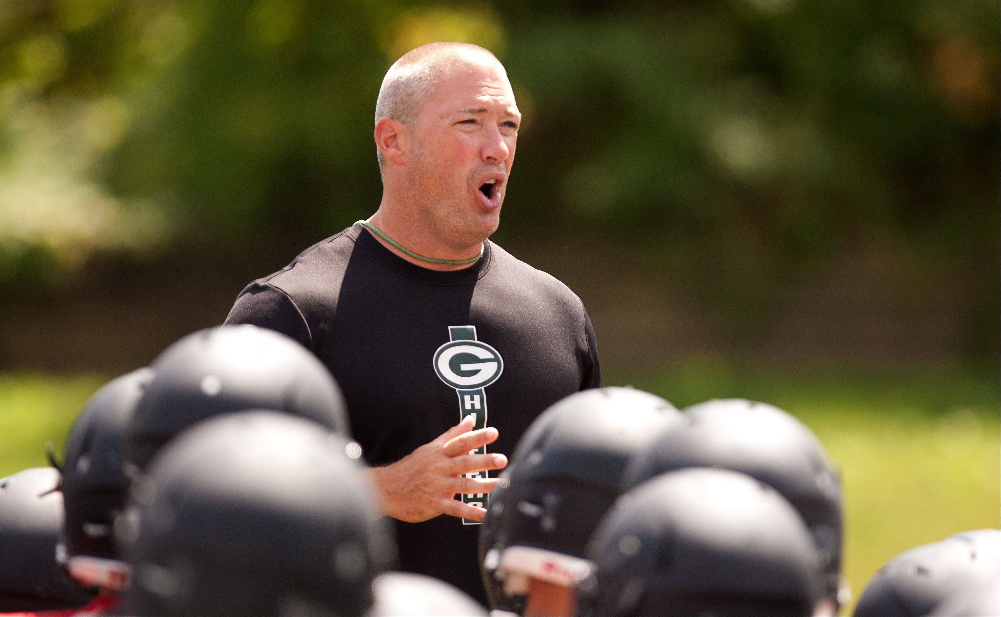 Glenbard West head football coach Chad Hetlet leads the first day of practice.