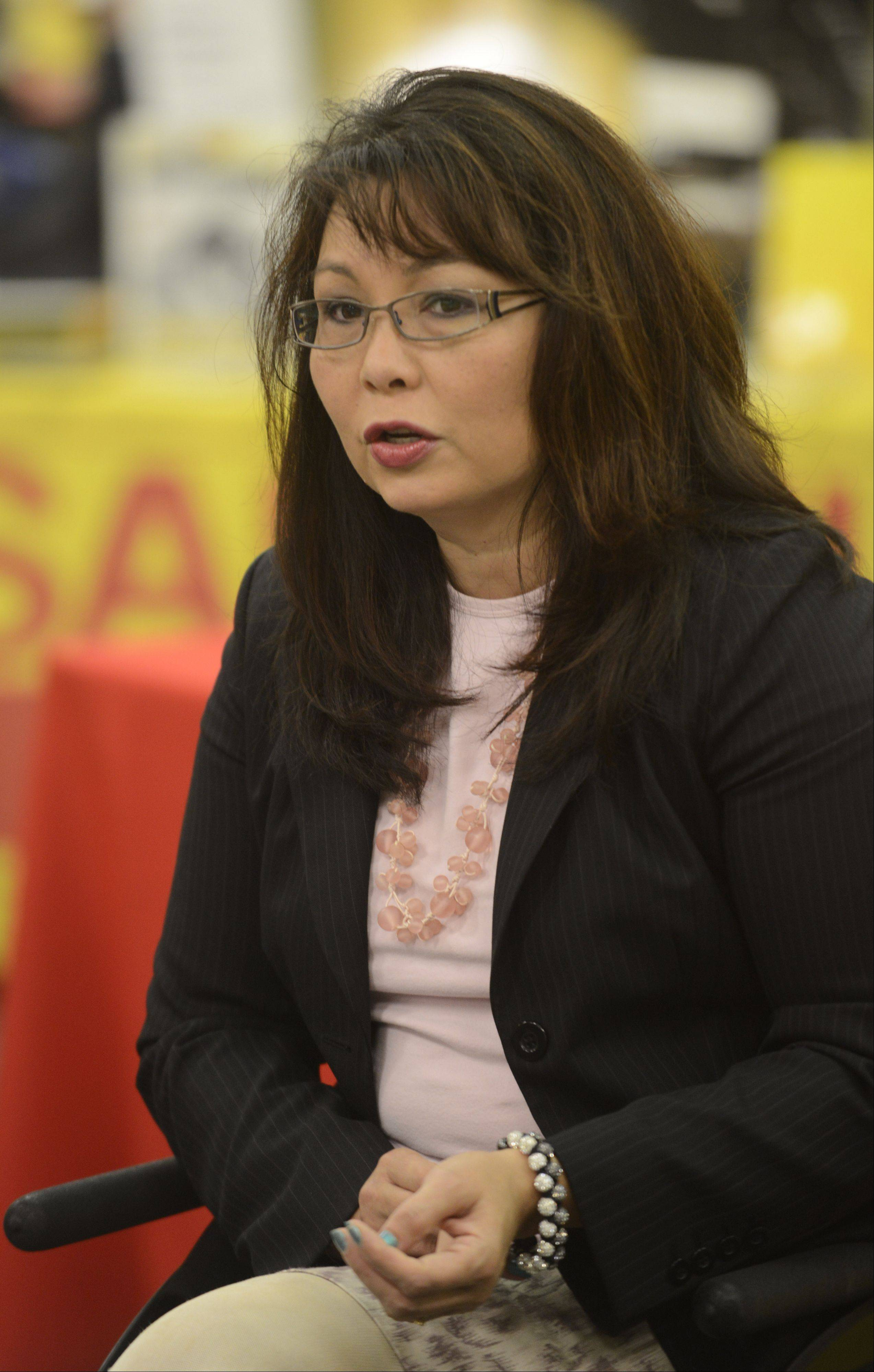 U.S. Rep Tammy Duckworth, a Hoffman Estates Democrat, attends a discussion on manufacturing and its importance to the region Friday at Sandvik Coromant Co. in Schaumburg.