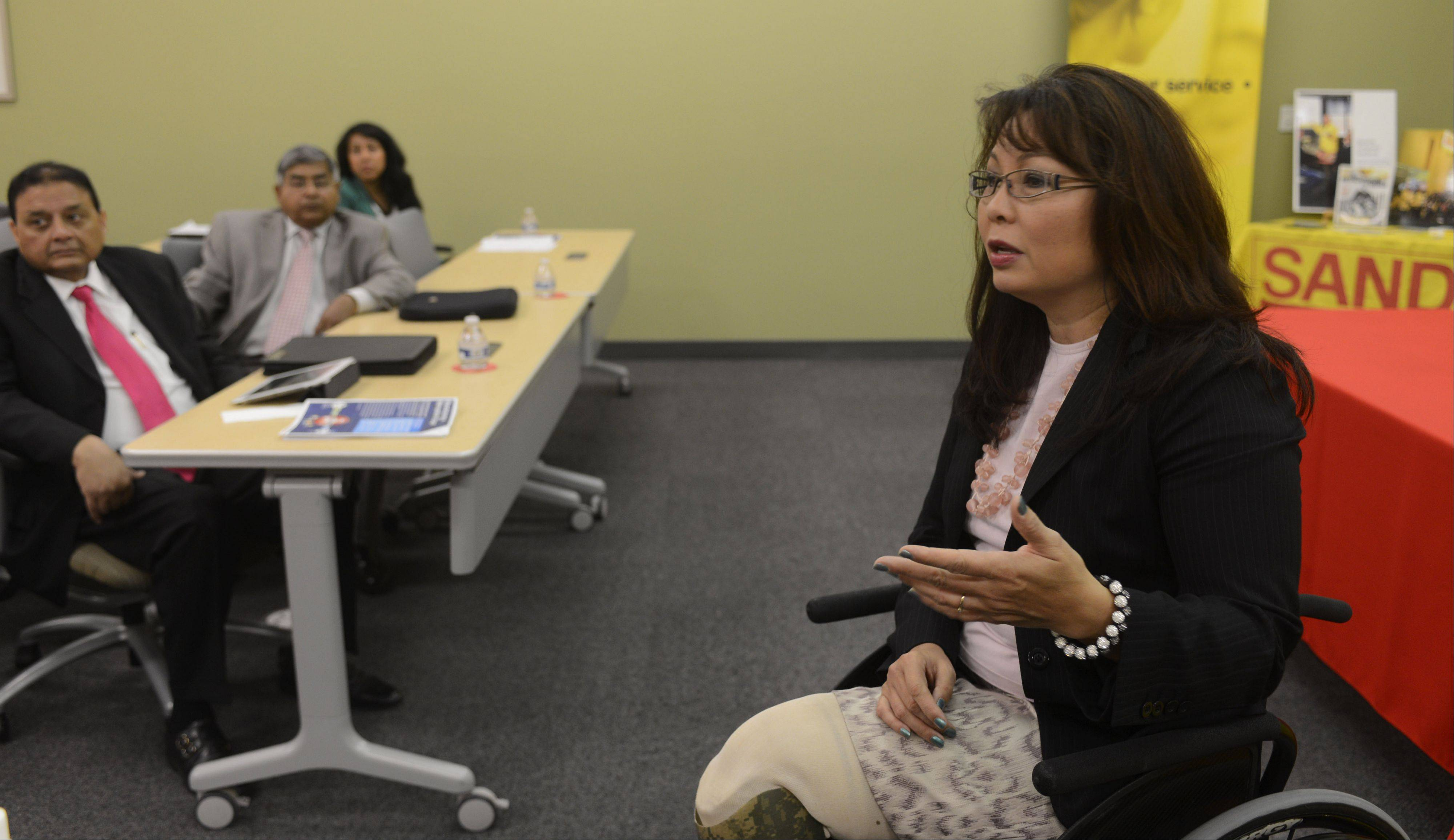 U.S. Rep. Tammy Duckworth, a Hoffman Estates Democrat, attends a discussion on manufacturing and its importance to the suburban region Friday at Sandvik Coromant Co. in Schaumburg.