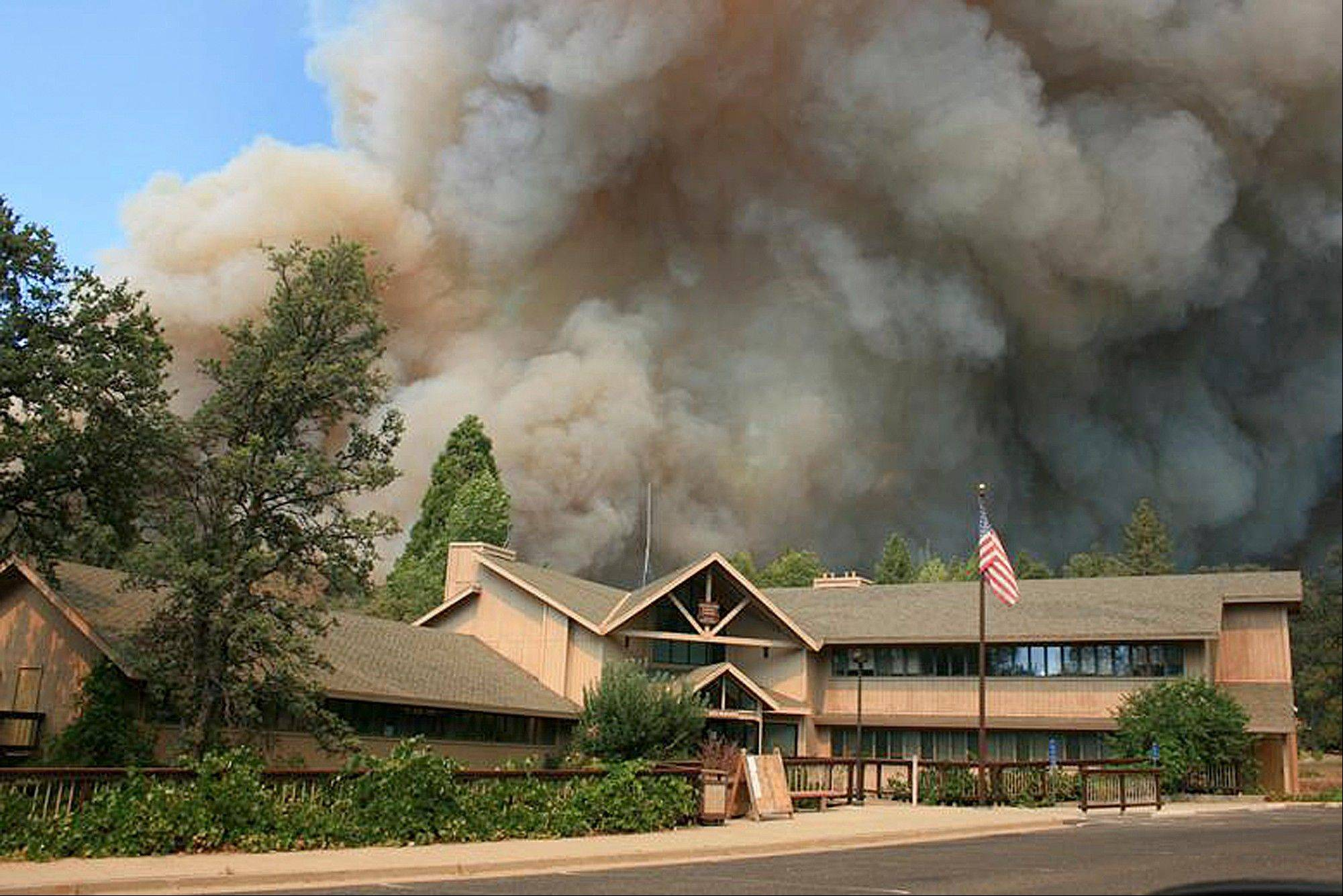 In this undated photo provided by the U.S. Forest Service, the Rim Fire burns near Groveland Ranger Station in Groveland, Calif. The wildfire outside Yosemite National Park � one of more than 50 major brush blazes burning across the western U.S. � more than tripled in size overnight and still threatens about 2,500 homes, hotels and camp buildings. Fire officials said the blaze burning in remote, steep terrain had grown to more than 84 square miles and was only 2 percent contained on Thursday, down from 5 percent a day earlier.