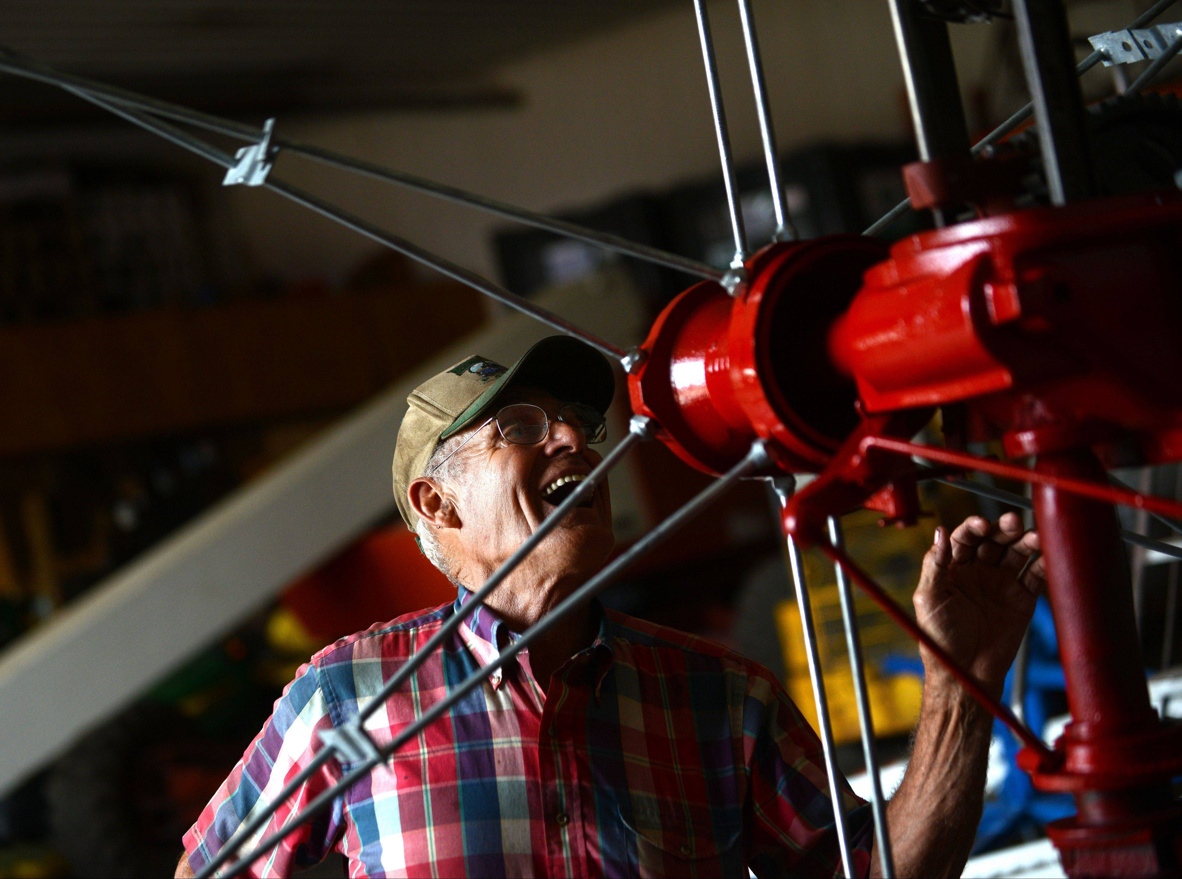 Frank Engel of Hampshire works on a windmill in his barn workshop.