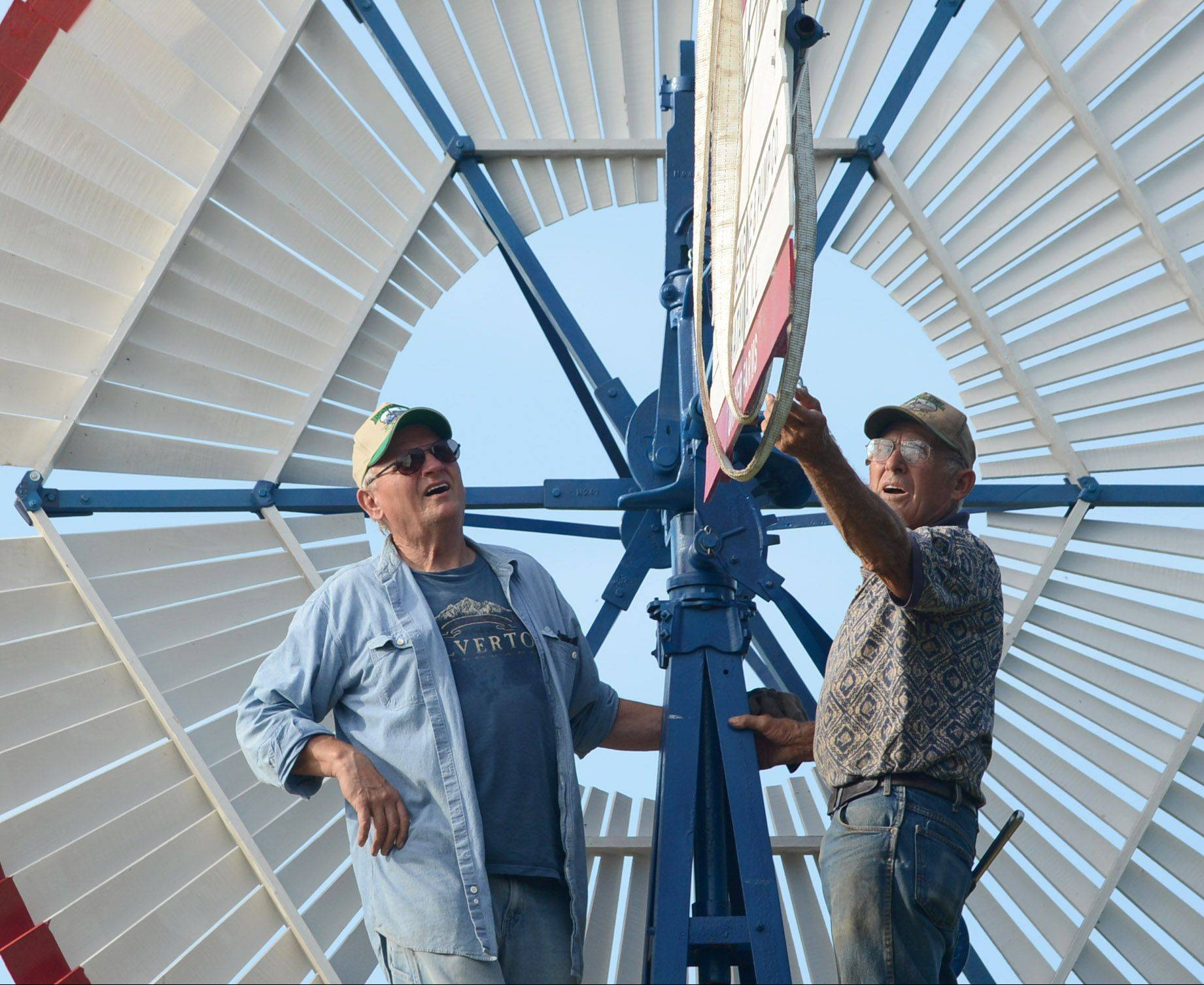 Frank Engel and friend Bill Chidester of Sheridan put up a windmill for Jim Turner in Garden Prairie.