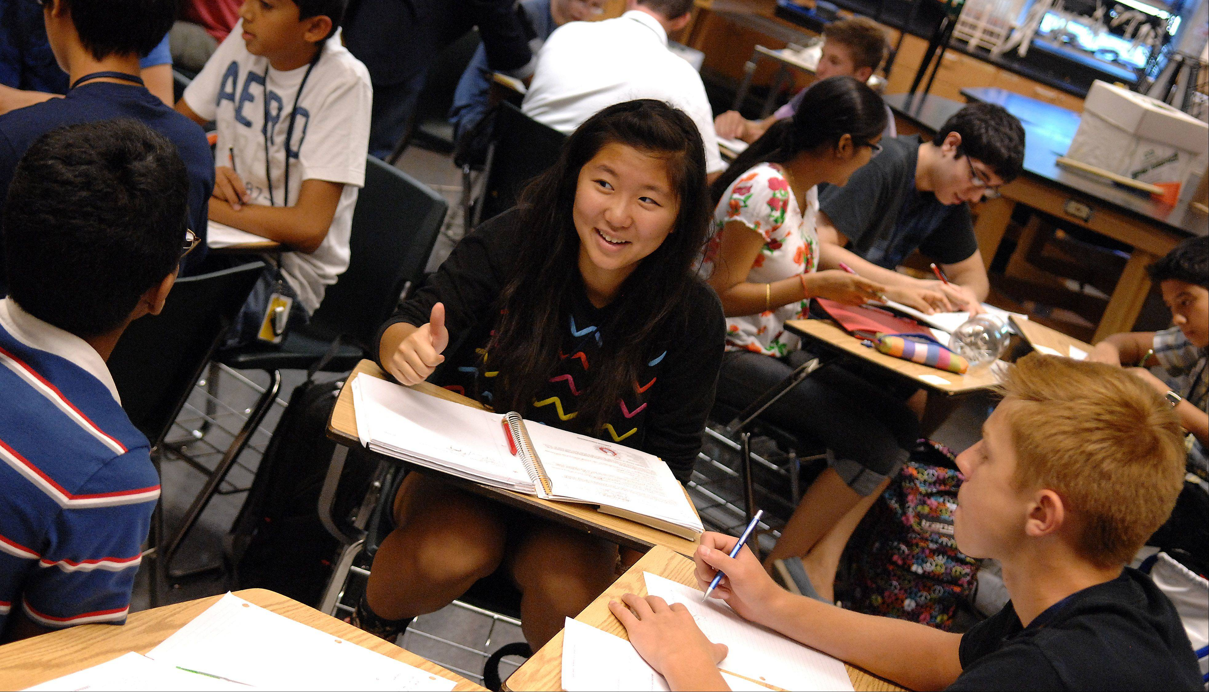 Autumn Chung works in a small group during a freshman biology class at the Academy of Science, Engineering and Technology housed at Bartlett High School.