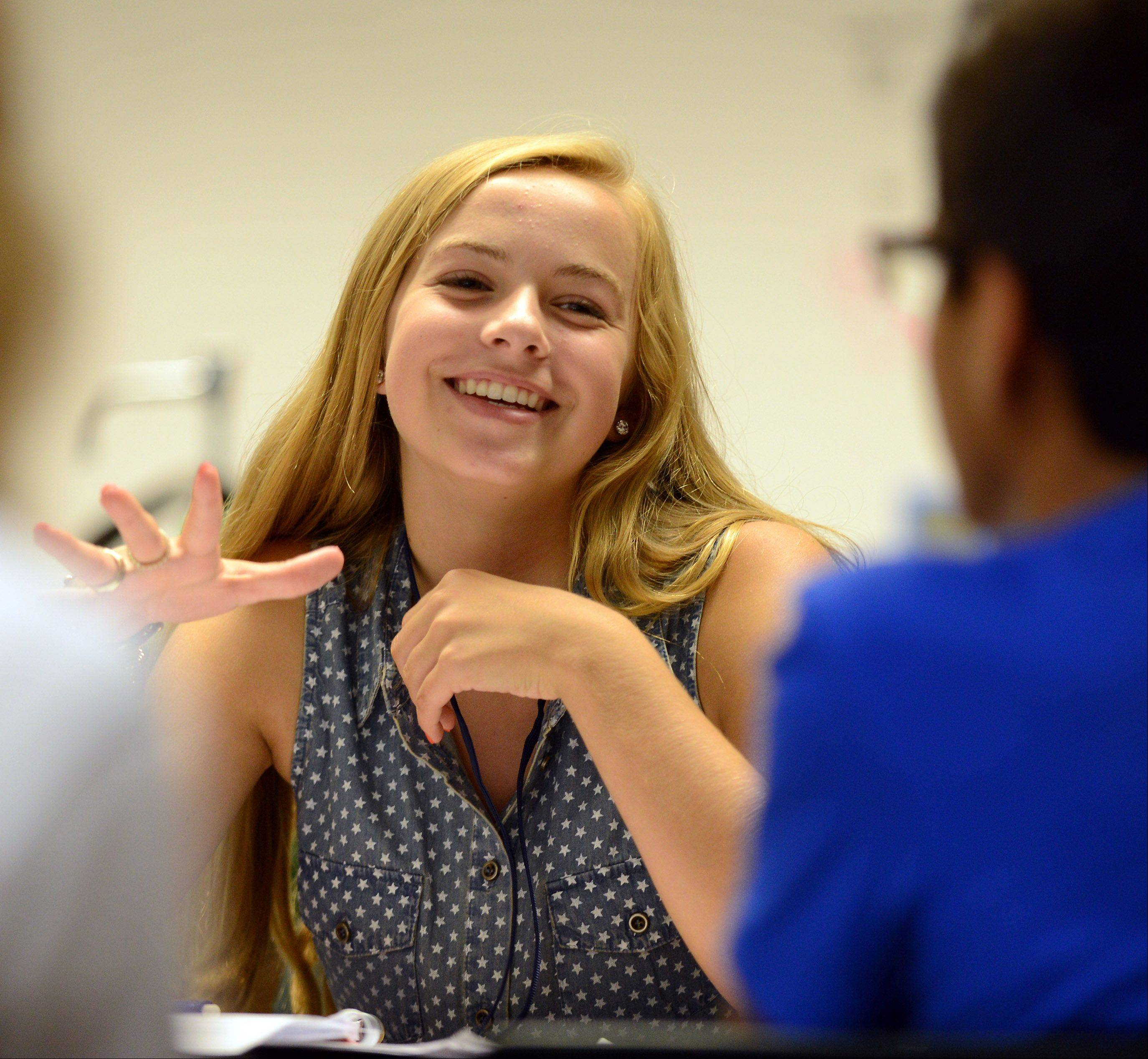 Marissa Gustafson works with a classmate during a freshman biology class at the Academy of Science, Engineering and Technology housed at Bartlett High School.