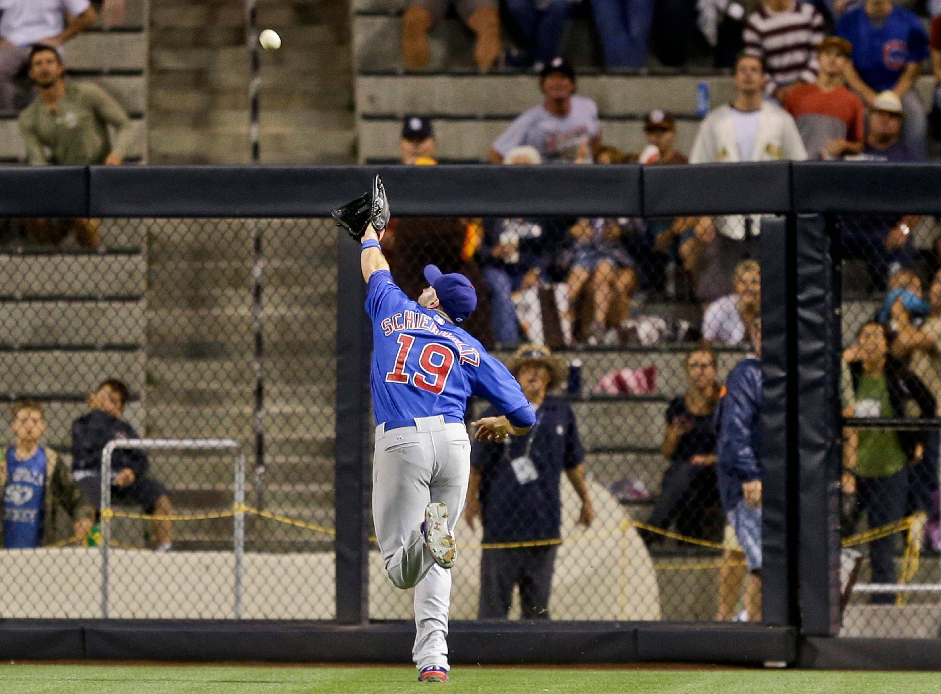 Cubs right fielder Nate Schierholtz can't reach a triple hit by the Padres' Logan Forsythe in the sixth inning Friday night in San Diego.