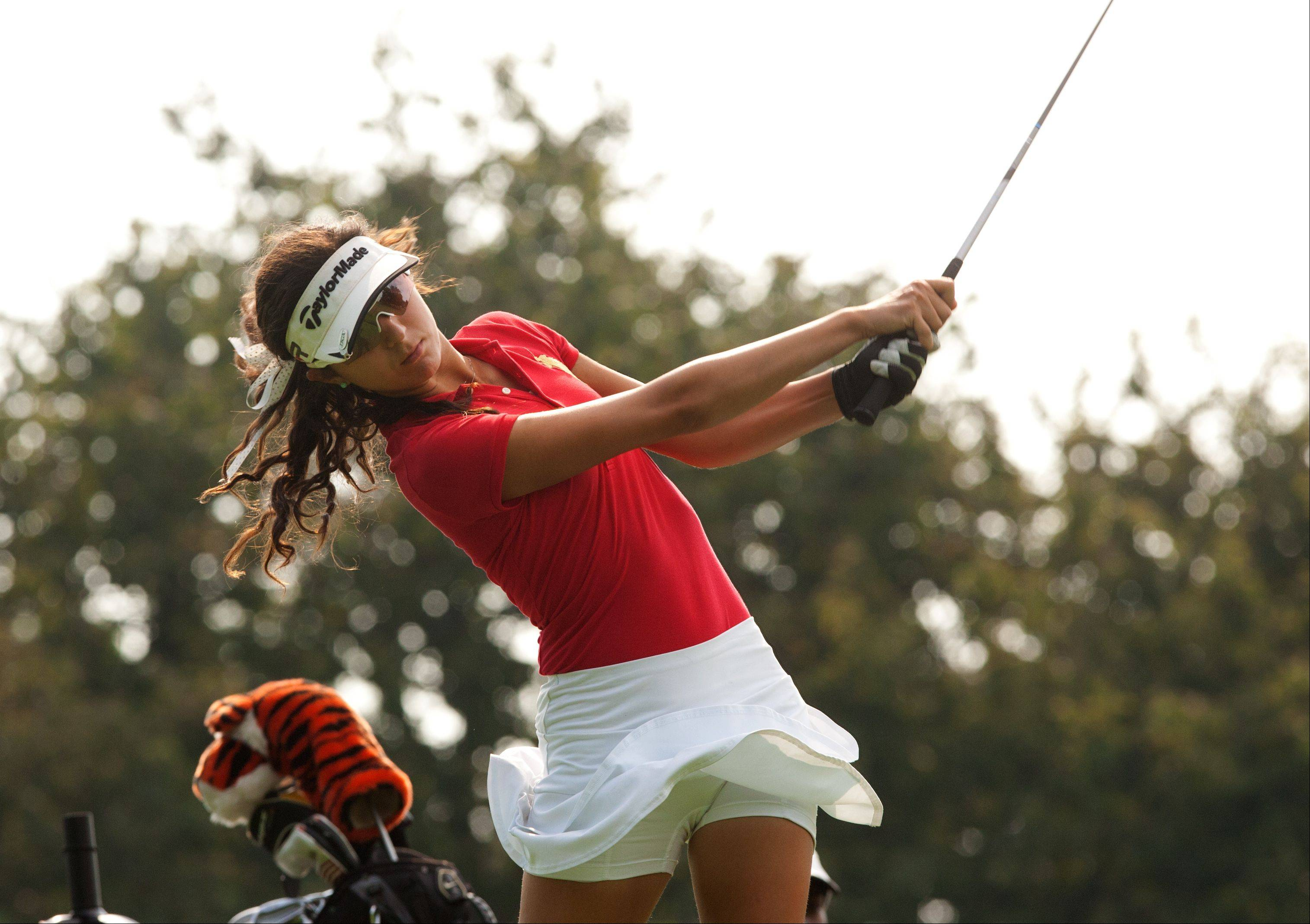 Isablella Abbdula of Benet tees off during the 2013 Vern McGonagle Memorial boys and girls golf invitational at the Naperville Country Club.