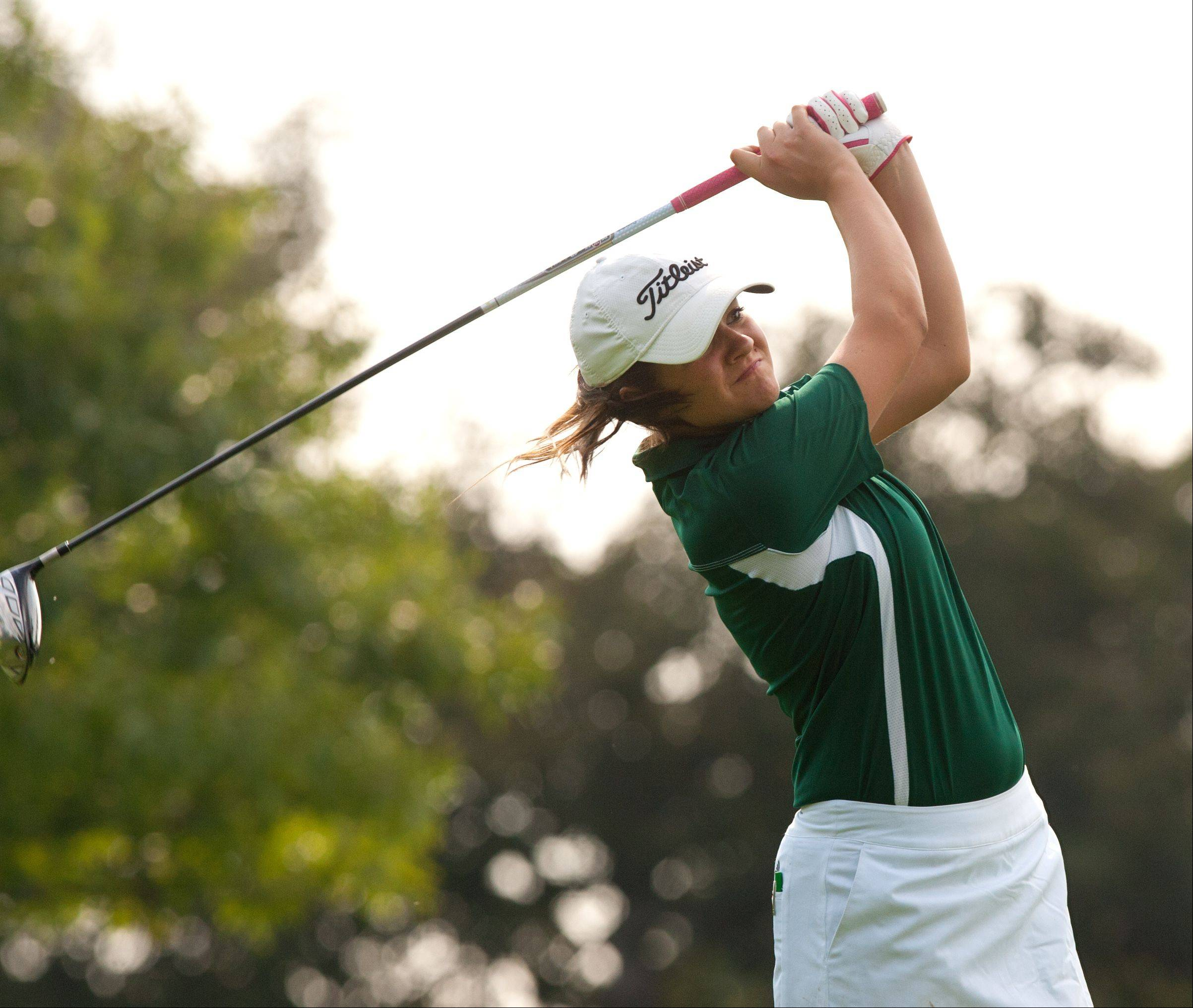 Rebecca O'Bryan of Waubonsie Valley tees off during the 2013 Vern McGonagle Memorial boys and girls golf invitational at the Naperville Country Club.