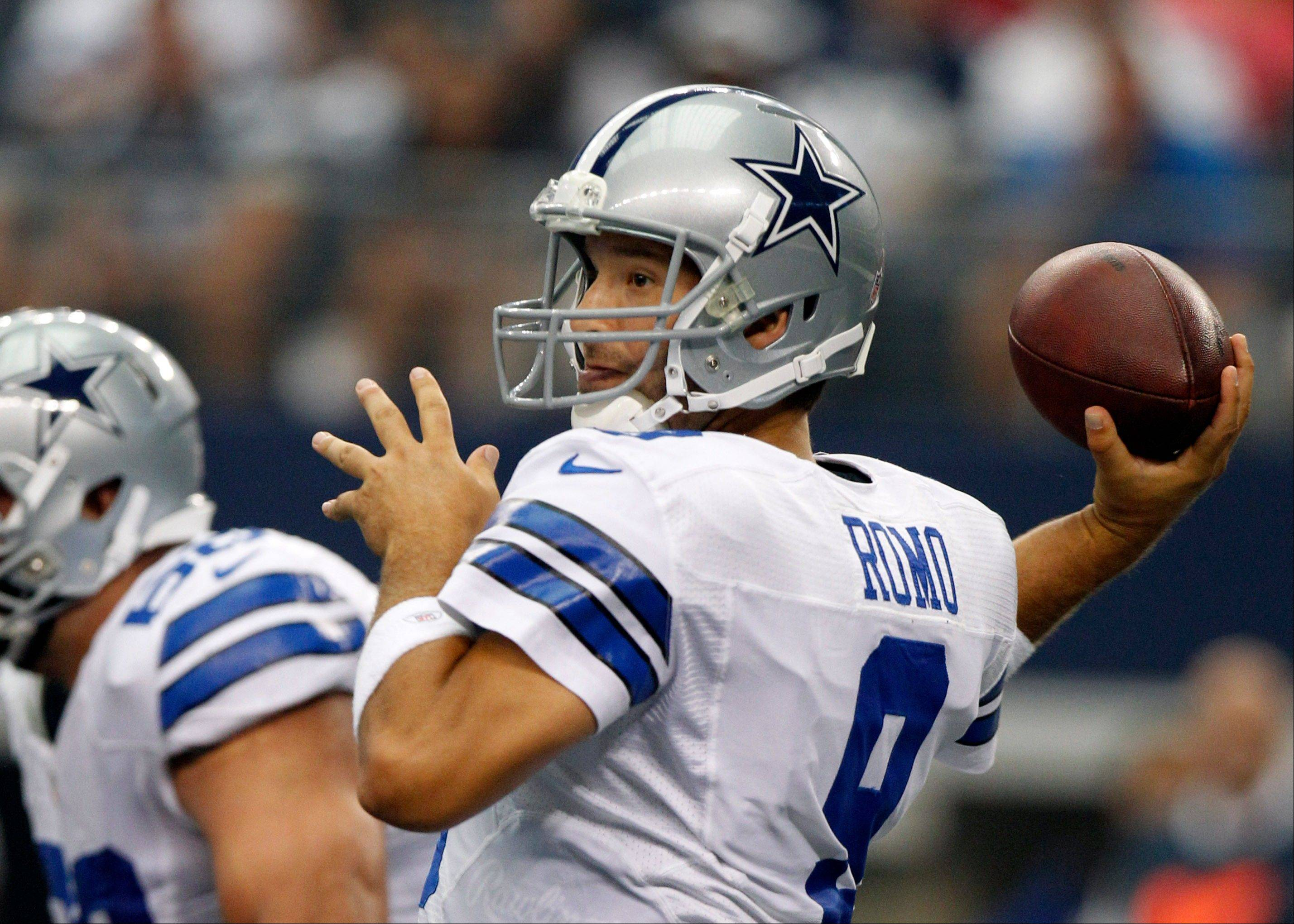 Dallas Cowboys quarterback Tony Romo (9) passes the ball against the Tampa Bay Buccaneers during the first half of an NFL football game on Sunday, Sept. 23, 2012, in Arlington, Texas.