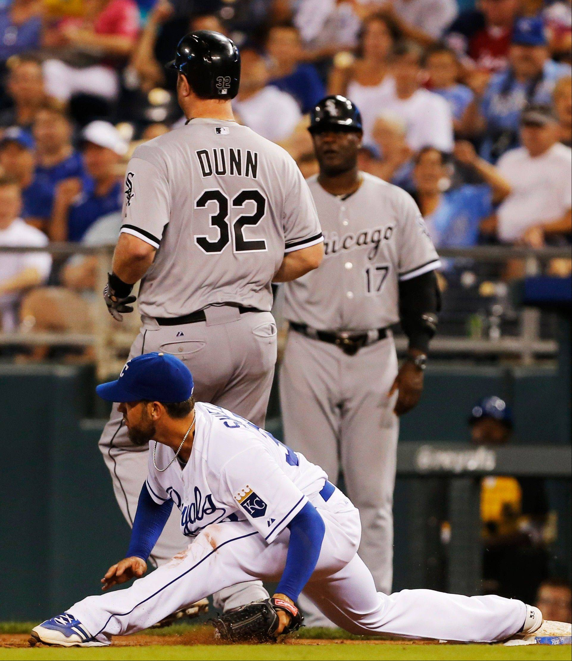 The White Sox's Adam Dunn (32) beats out a throw to Kansas City Royals starting pitcher James Shields during Thursday night's game in Kansas City, Mo. The Sox beat the Royals 4-3 in 12 innings.