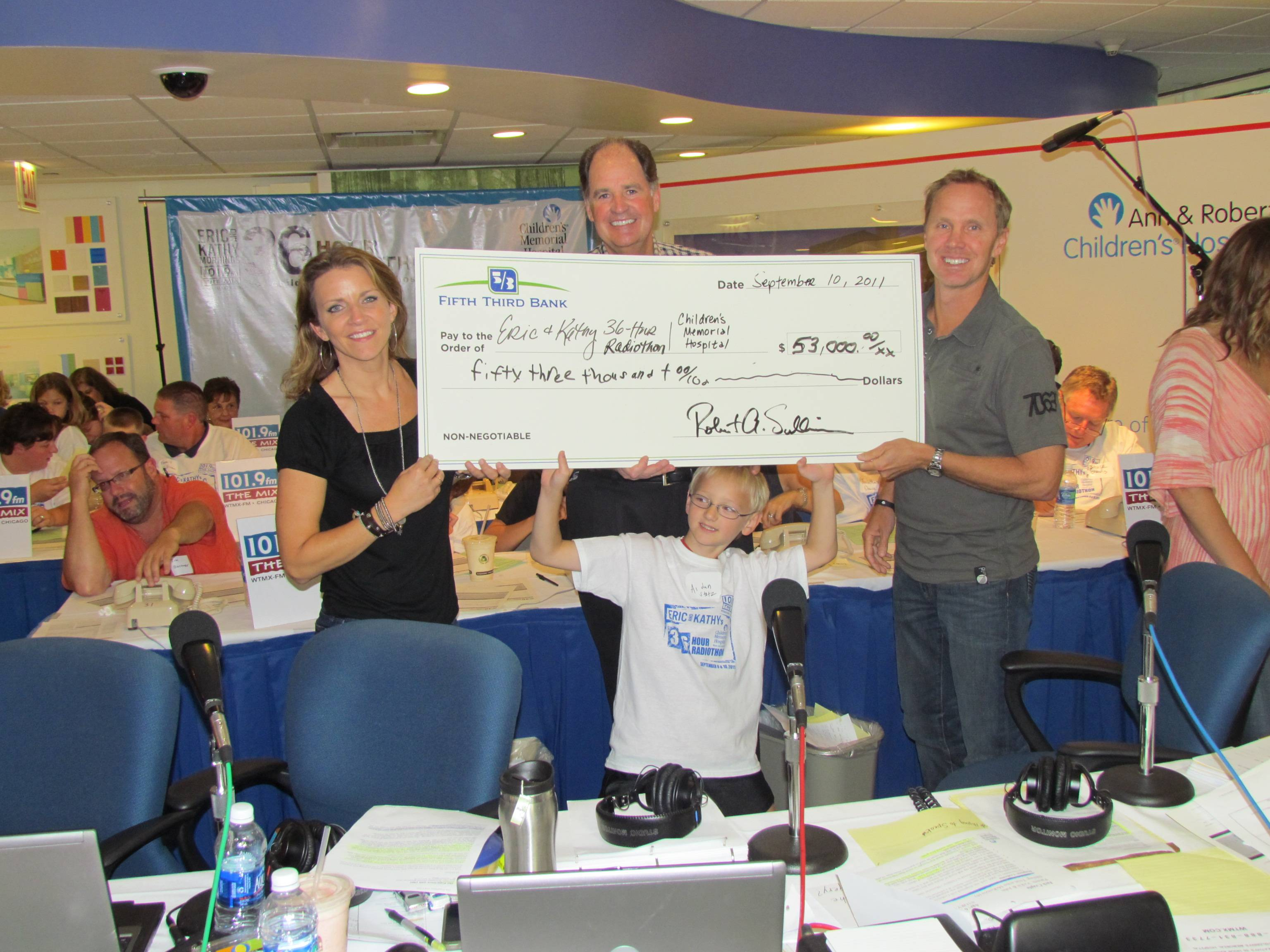 Bob Sullivan, Presidenet & CEO, Fifth Third Bank president (in center) presents a check for $53,000 to radio duo Eric & Kathy in 2011.