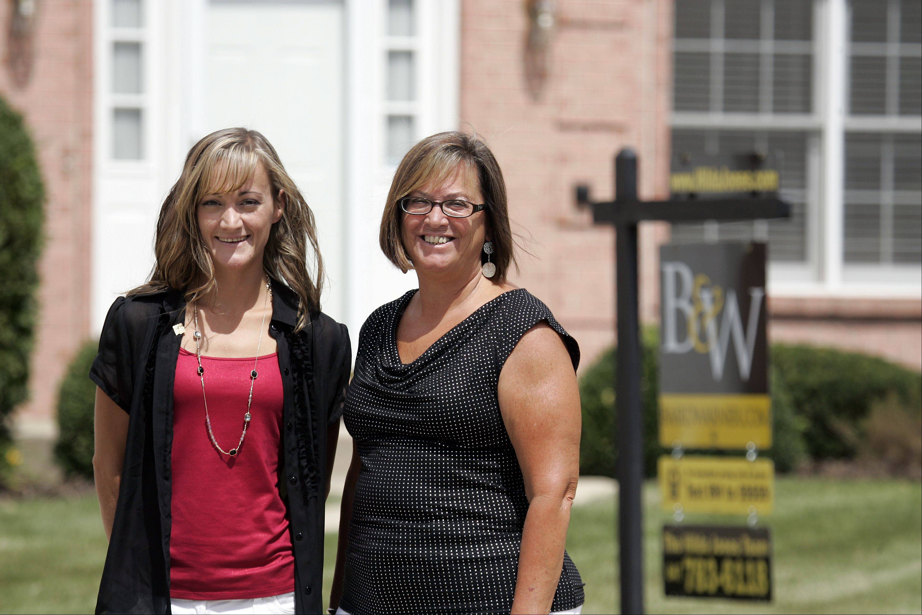 Hilda Jones, right, and her daughter Jennifer combine powers to make a mother-daughter Realtor team. They are marketing this house in Algonquin.