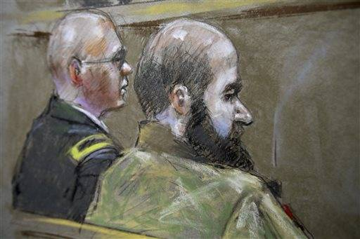 In this Aug. 21 file courtroom sketch, U.S. Army Maj. Nidal Malik Hasan, right, and his defense attorney, Lt. Col. Kris Poppe, are shown during Hasan's court-martial trial in Fort Hood, Texas. Hasan has been convicted of murder for the 2009 shooting rampage at Fort Hood that killed 13 people and wounded more than 30 others.