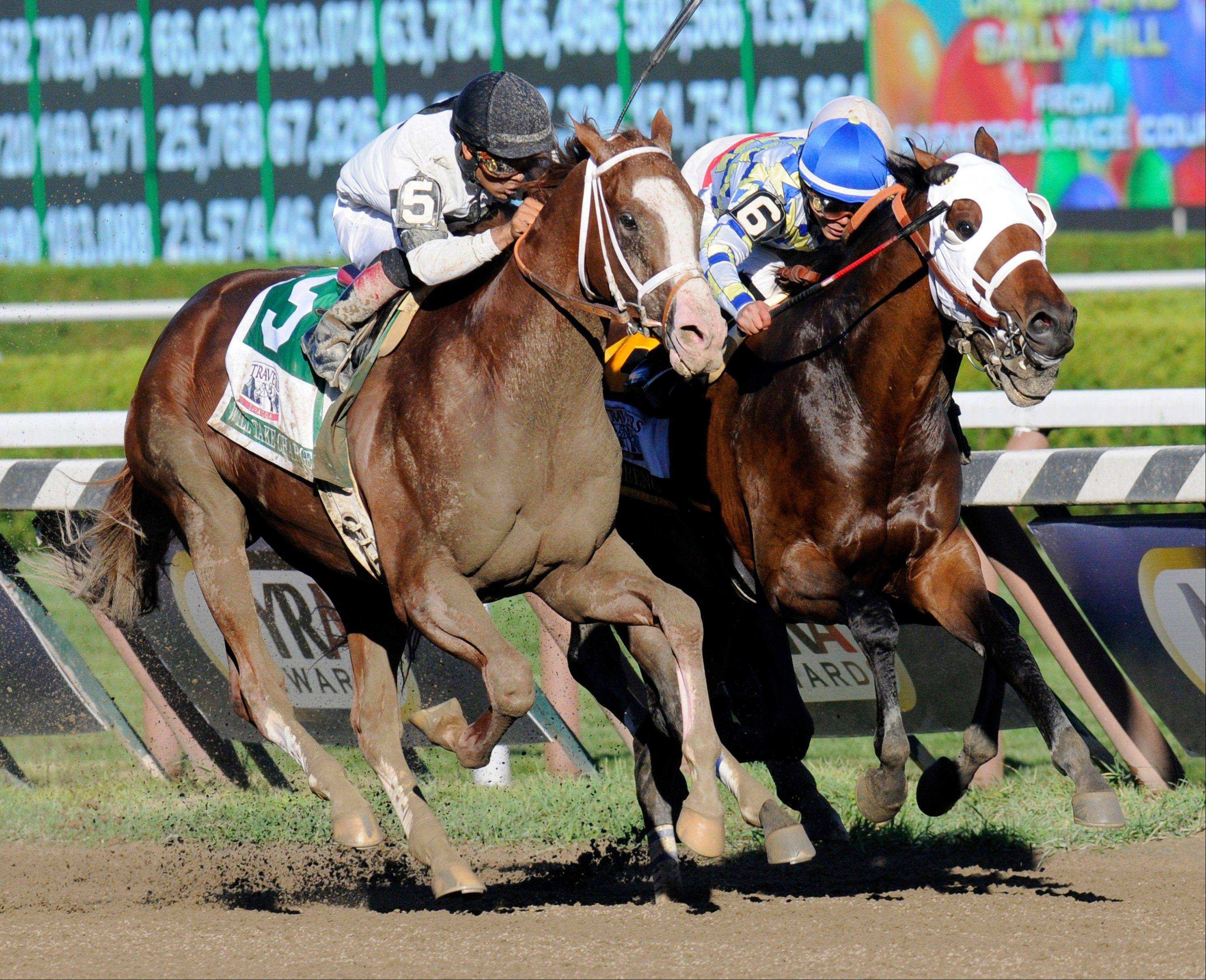 Will Take Charge, left, with jockey Luis Saez aboard, pulls past Moreno, with Jockey Jose L. Ortiz up, to win the Travers Stakes horse race at Saratoga Race Course in Saratoga Springs, N.Y., Saturday, Aug. 24, 2013. (AP Photo /Hans Pennink)