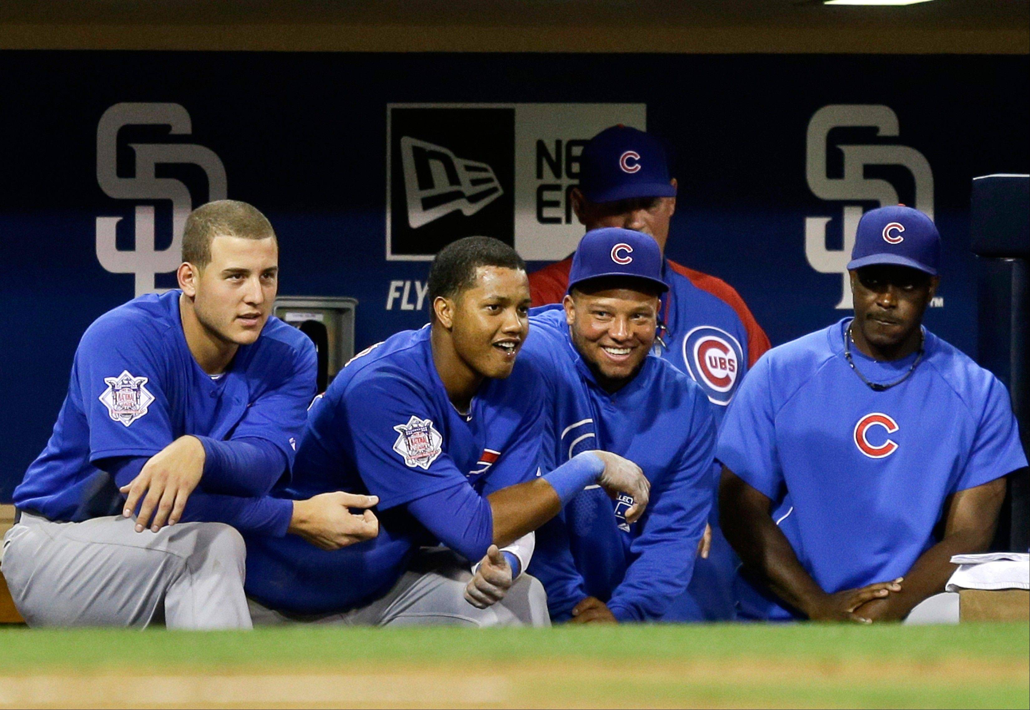 While he looks comfortable here, Cubs shortstop Starlin Castro, second from left, hasn't played that way at the plate or in the field this season.