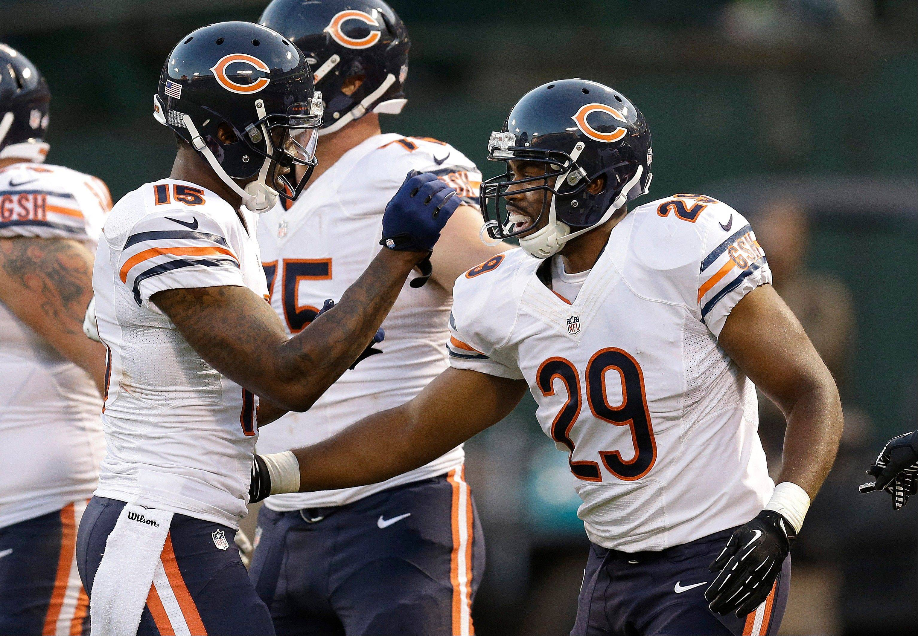 Chicago Bears running back Michael Bush (29) celebrates his touchdown with wide receiver Brandon Marshall (15) during the first quarter.
