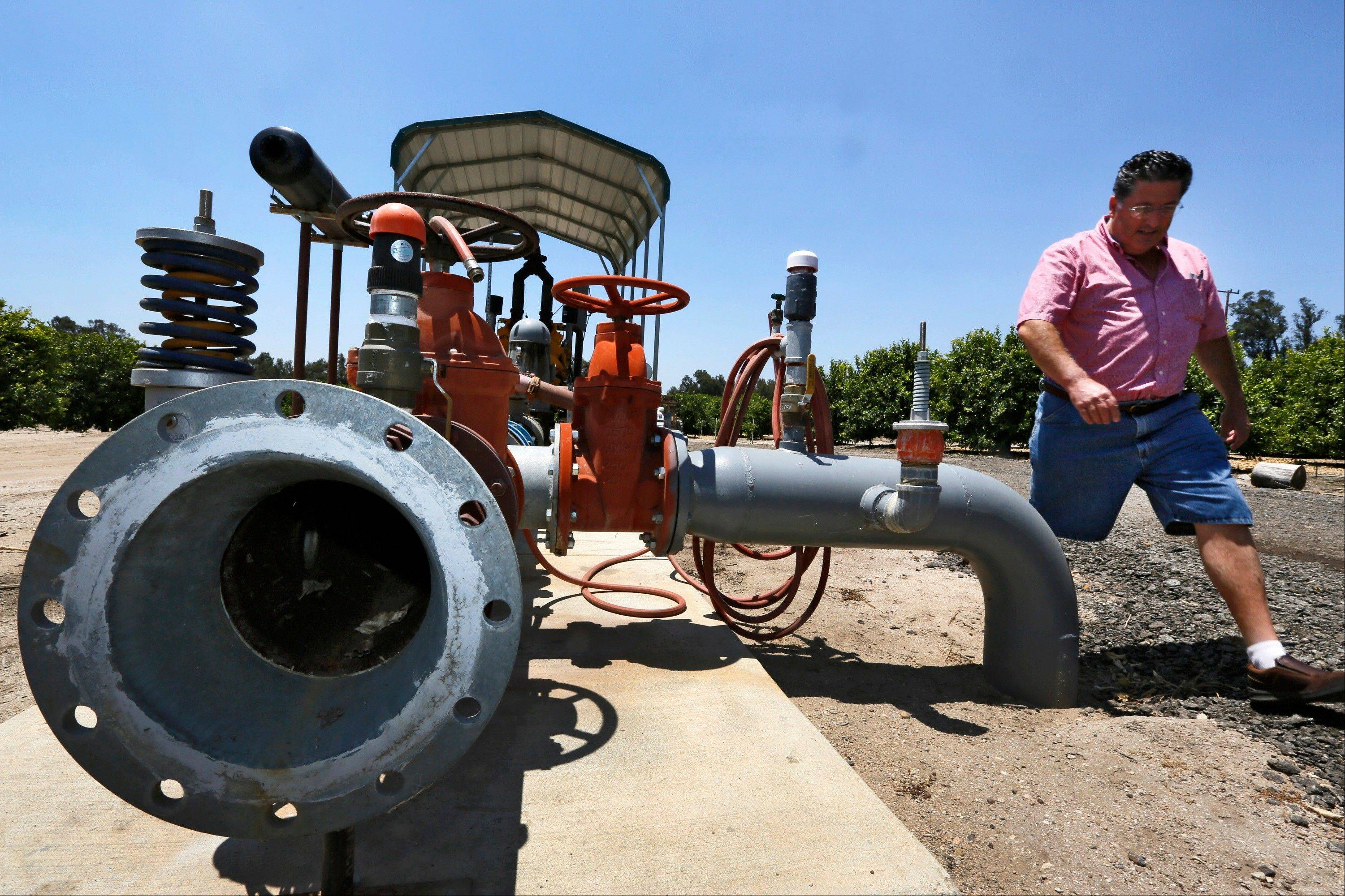 Schwabauer tours his property's irrigation system. For years Schwabauer has watched groundwater levels retreat with higher demand from encroaching development, forcing ranchers and farmers to sink piping deeper into the earth or drill expensive, new wells for irrigation.