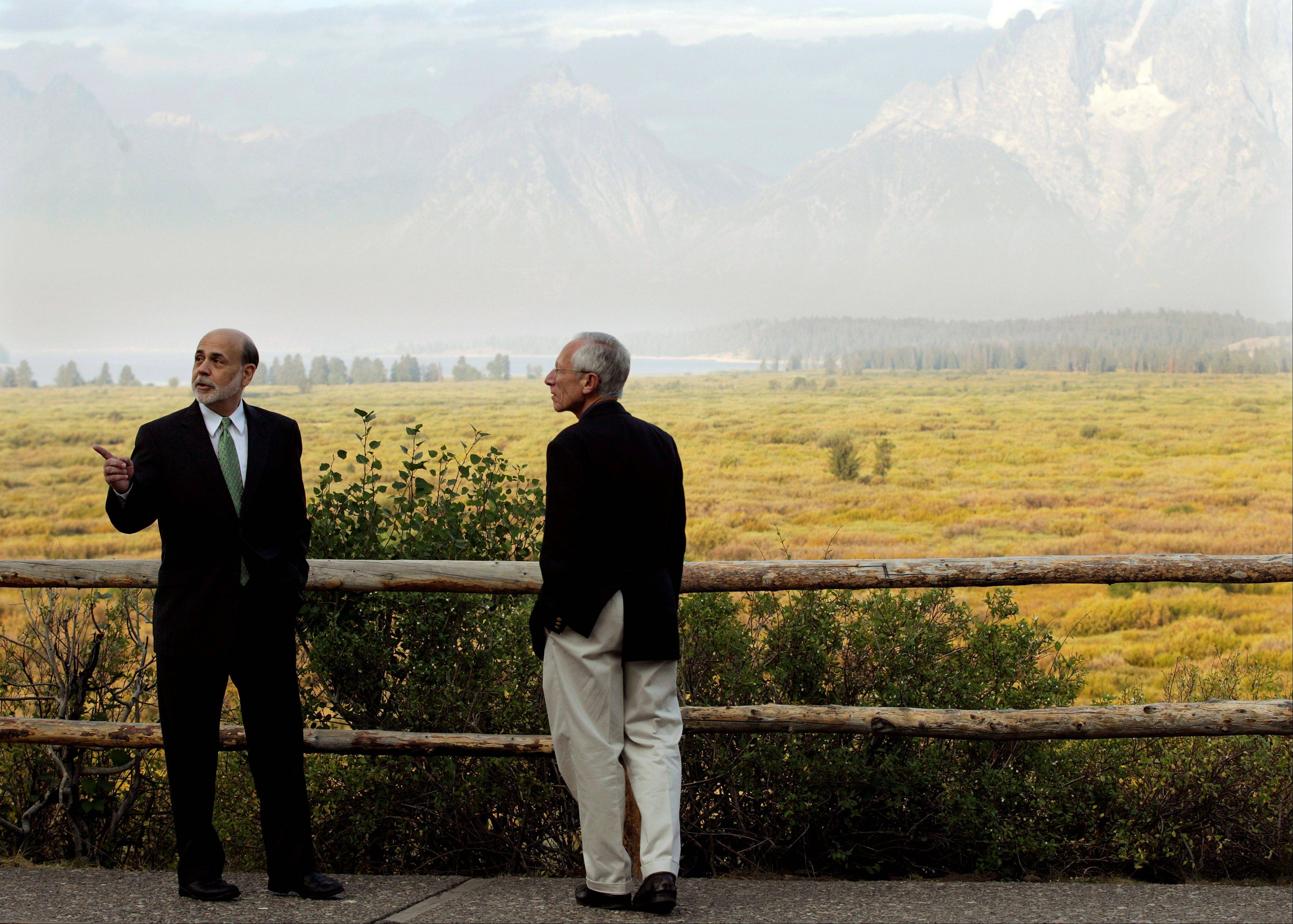 Federal Reserve Chairman Ben Bernanke, left, and Stanley Fischer, right, Governor of the Bank of Israel, talk together last year outside the Jackson Hole Economic Symposium, at Grand Teton National Park near Jackson Hole, Wyo.