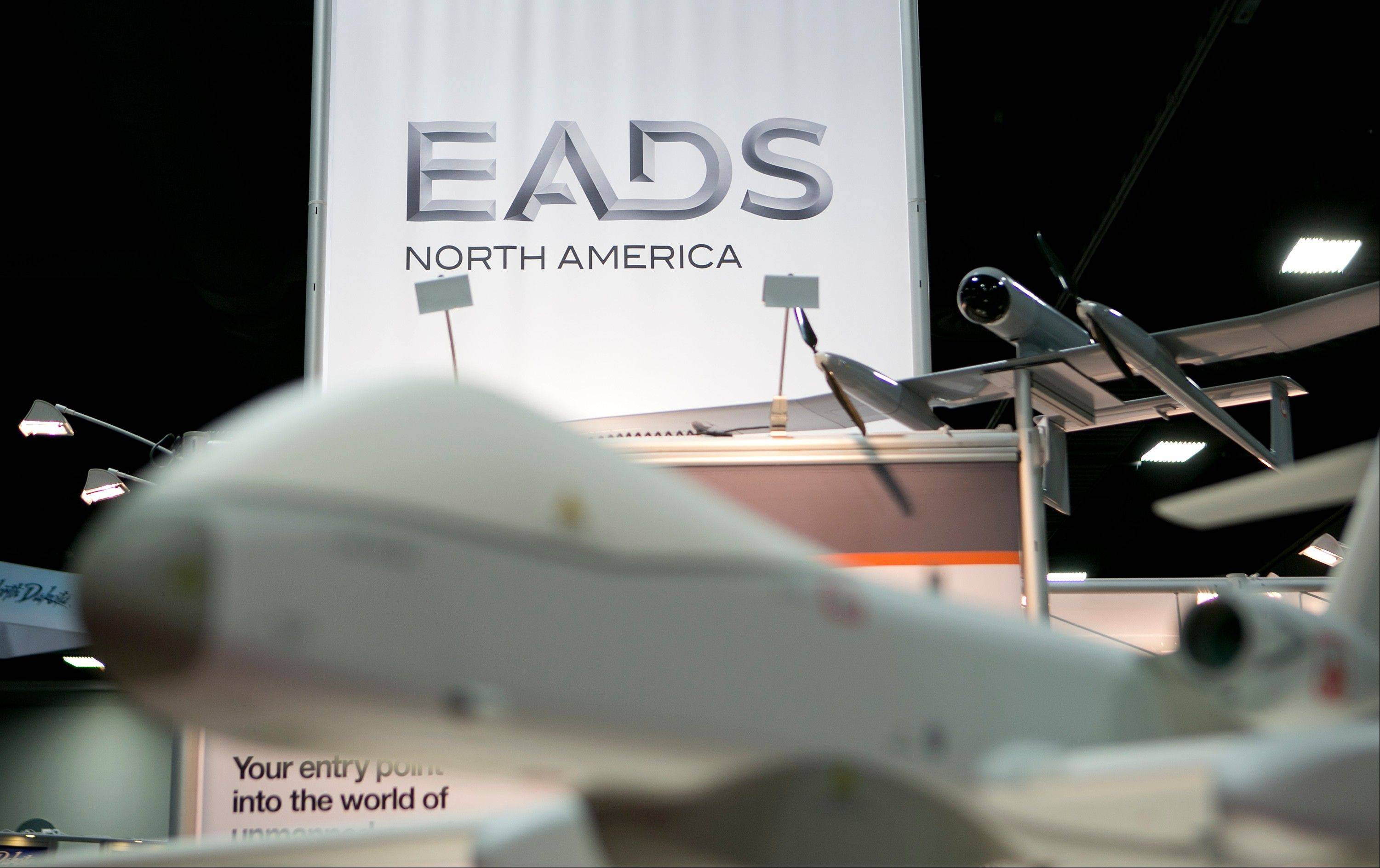 The European Aeronautic, Defence & Space Co. North America (EADS) logo is seen past a Cassidian Ltd., a unit of EADS, Future MALE unmanned aircraft system (UAS) on the exhibition floor at the Association for Unmanned Vehicle Systems International (AUVSI) unmanned systems conference in Washington. AUVSI is the world's largest nonprofit organization devoted exclusively to advancing the unmanned systems and robotics community.