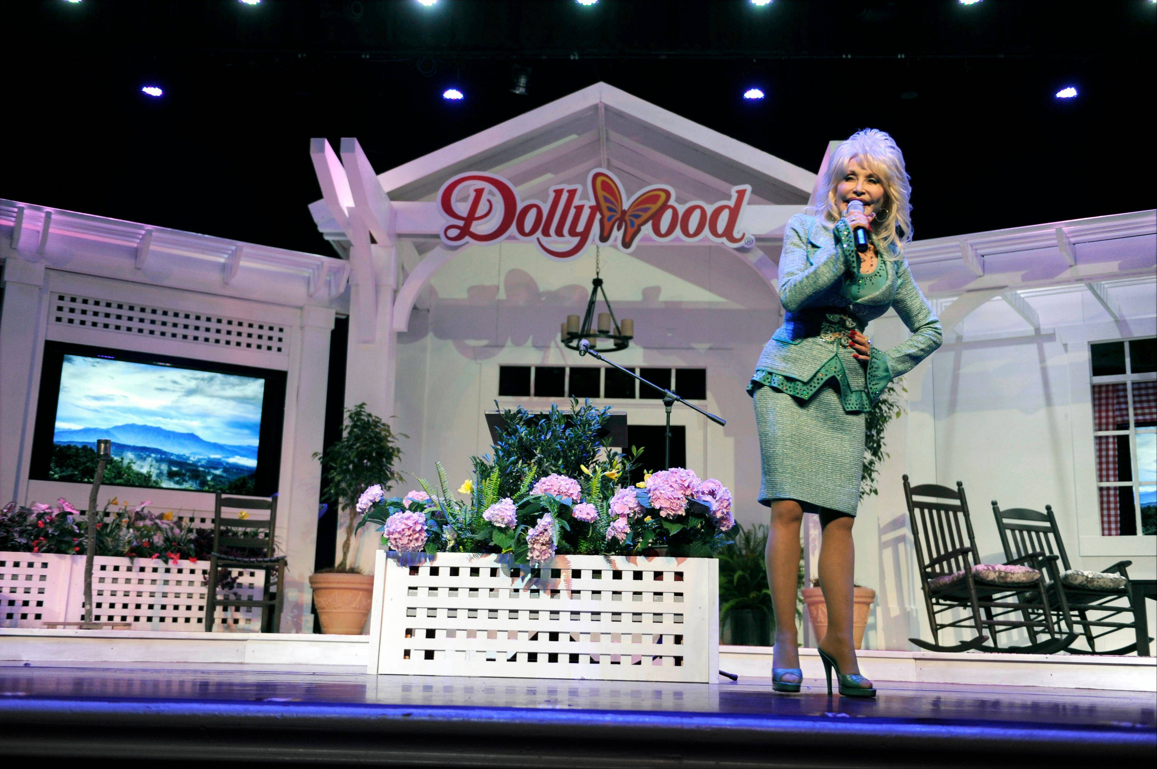 Dolly Parton speaks during a news conference to announce plans to expand her Dollywood properties in Pigeon Forge, Tenn. Parton said she is going invest $300 million over the next 10 years in a project that includes a 300-room resort.