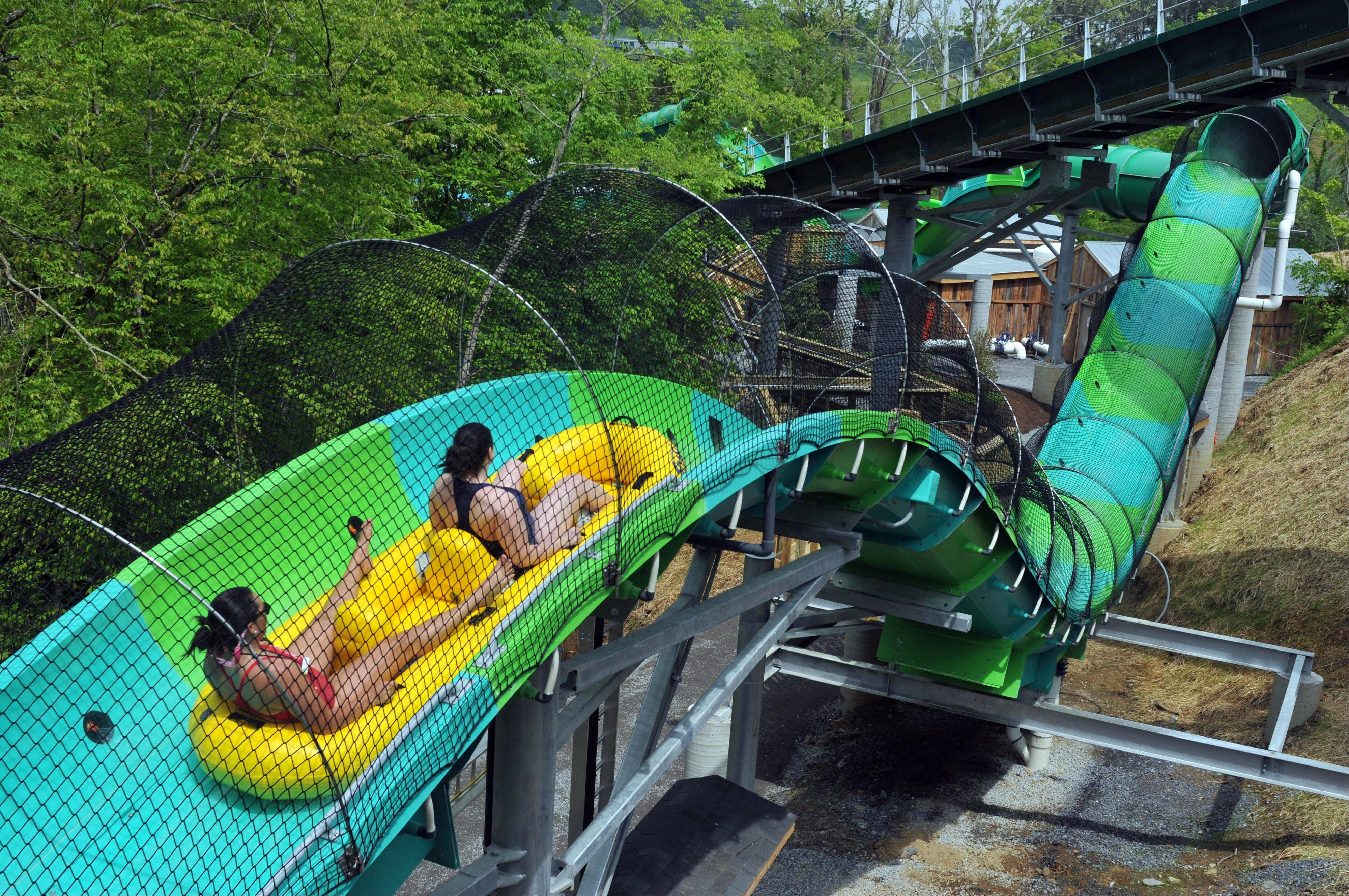 Visitors enjoy the RiverRush ride at the Dollywood theme park in Pigeon Forge, Tenn.
