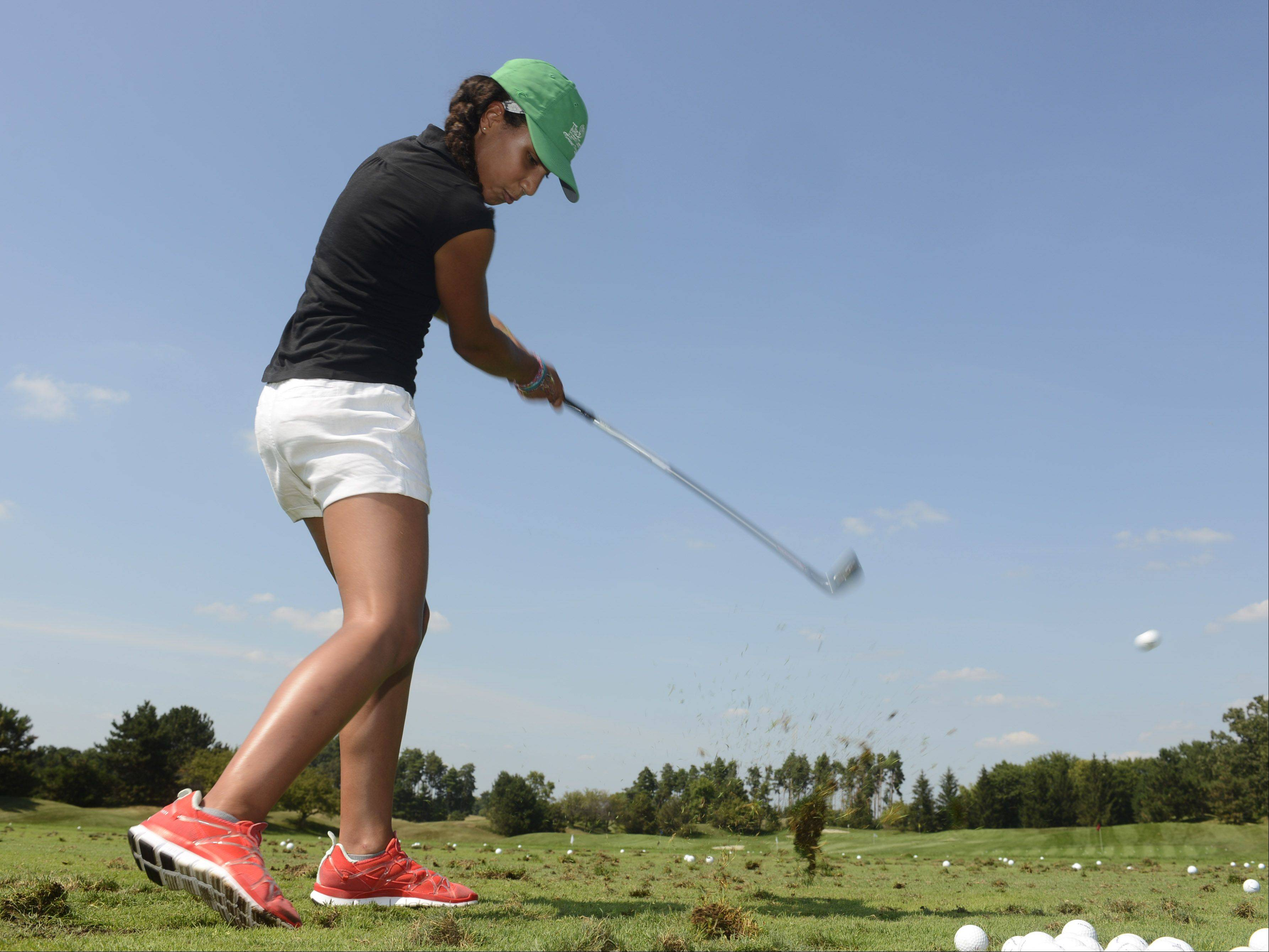 Thandi Steele, 13, of Evanston, hits a ball during the First Tee golf event at Ivanhoe Club near Mundelein. First Tee uses the game of golf to provide education programs that build character. Thirteen kids were rewarded for their good choices with a special day at Ivanhoe.