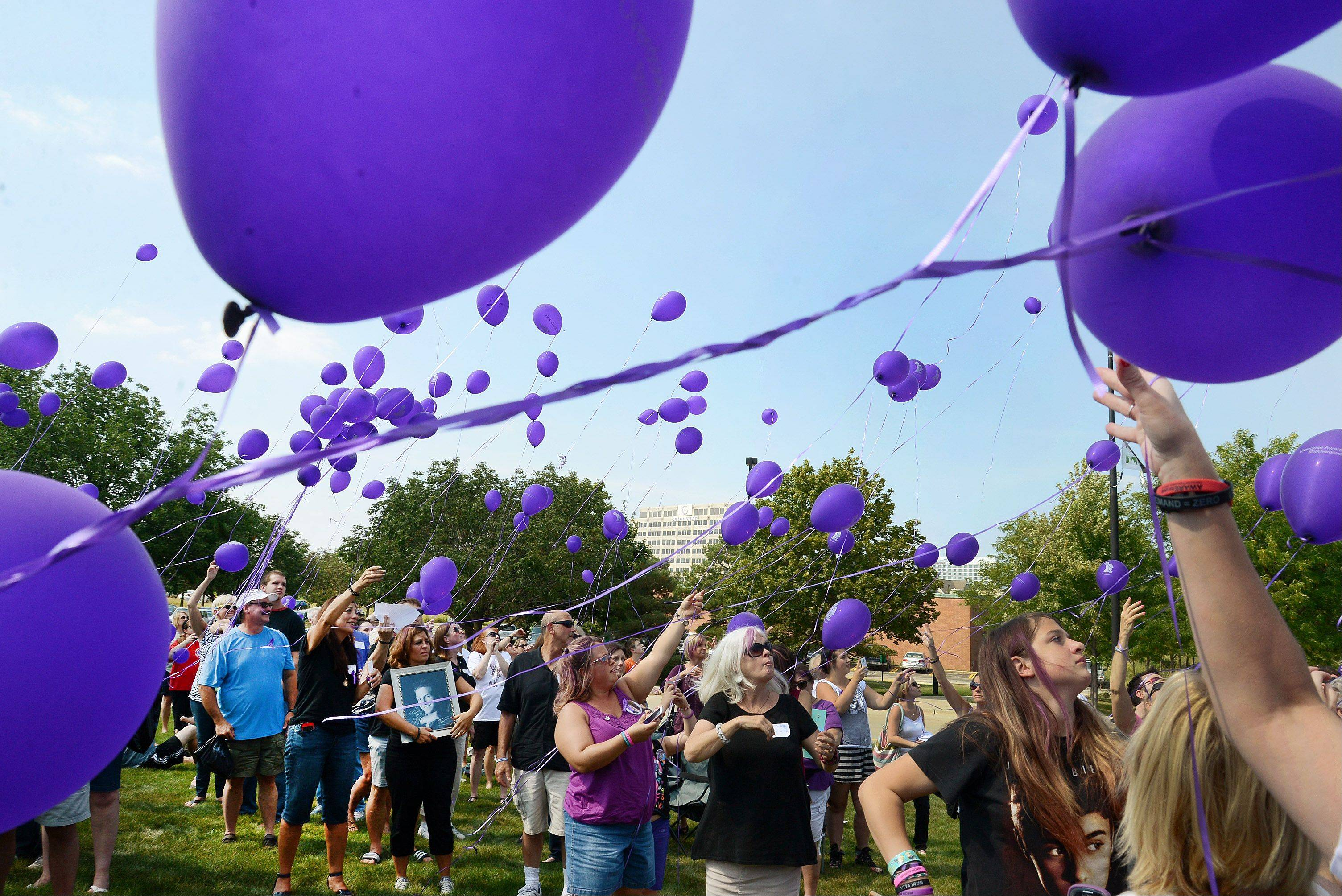 Participants at Saturday's International Overdose Awareness week kickoff ceremony at Roosevelt University's Schaumburg campus release balloons to remember loved ones who died from overdoses.