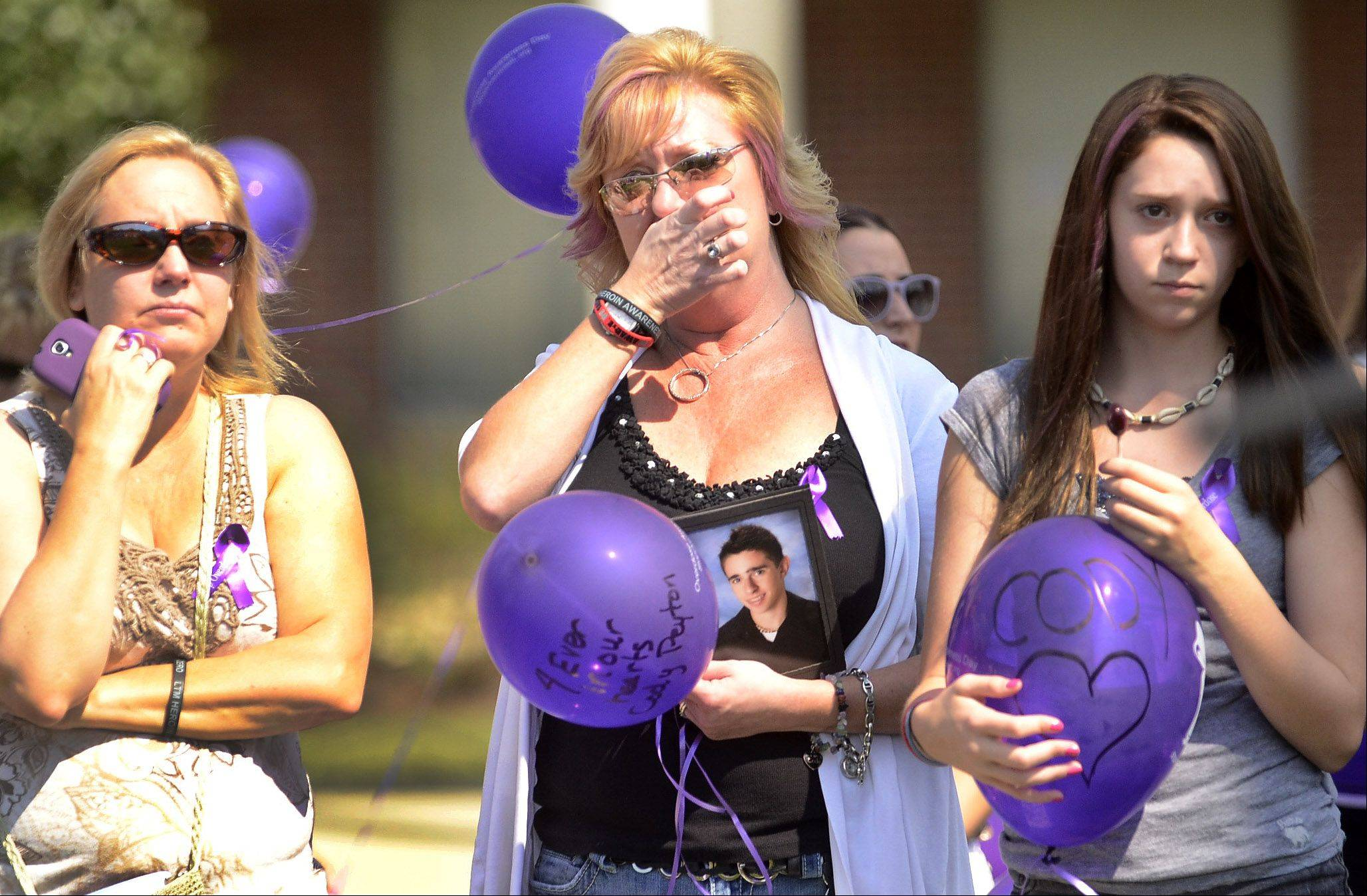 Robbie Heller of Aurora, from left, Kathy Cada of Batavia and Jillian Peyton of Batavia remember Kathy's son Cody, who died last year at age 20 of an overdose.