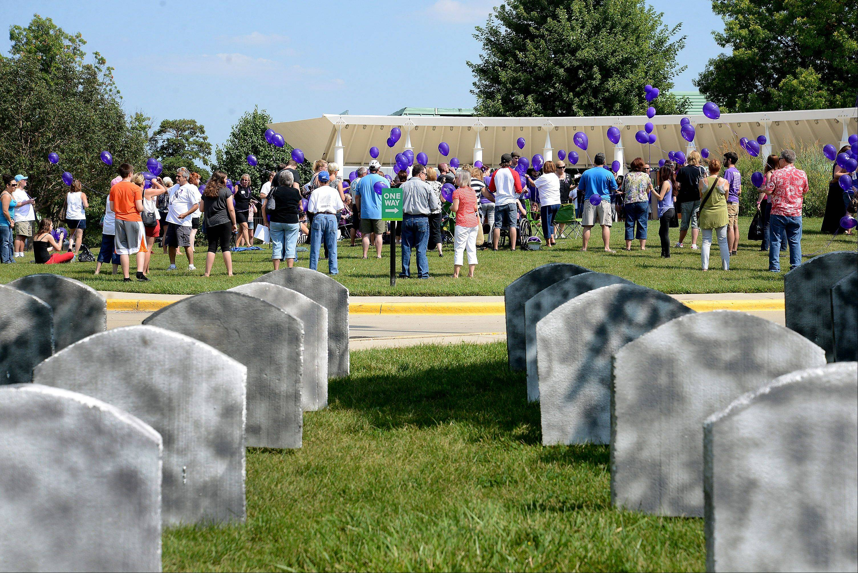 To illustrate the number of people who die from drug overdoses each day, organizers of Saturday's kickoff event for International Overdose Awareness week created a makeshift cemetery with 100 tombstones outside the event.