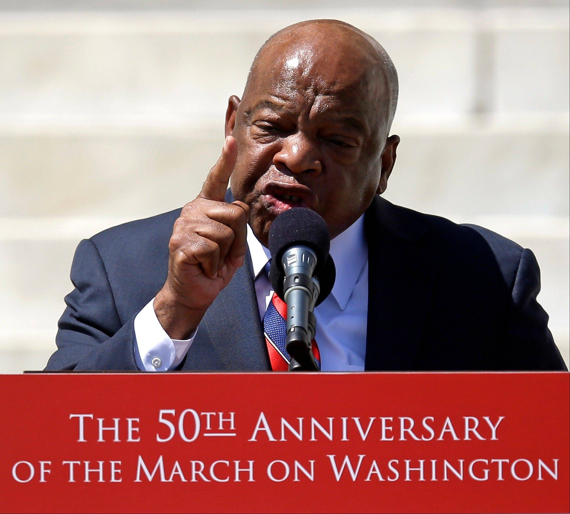 "Civil rights leader Rep. John Lewis, a Georgia Democrat, speaks at a rally to commemorate the 50th anniversary of the 1963 March on Washington on the steps of the Lincoln Memorial. Lewis marched in the front line with the Rev. Martin Luther King Jr. the day King gave his famous ""I Have a Dream"" speech in 1963."