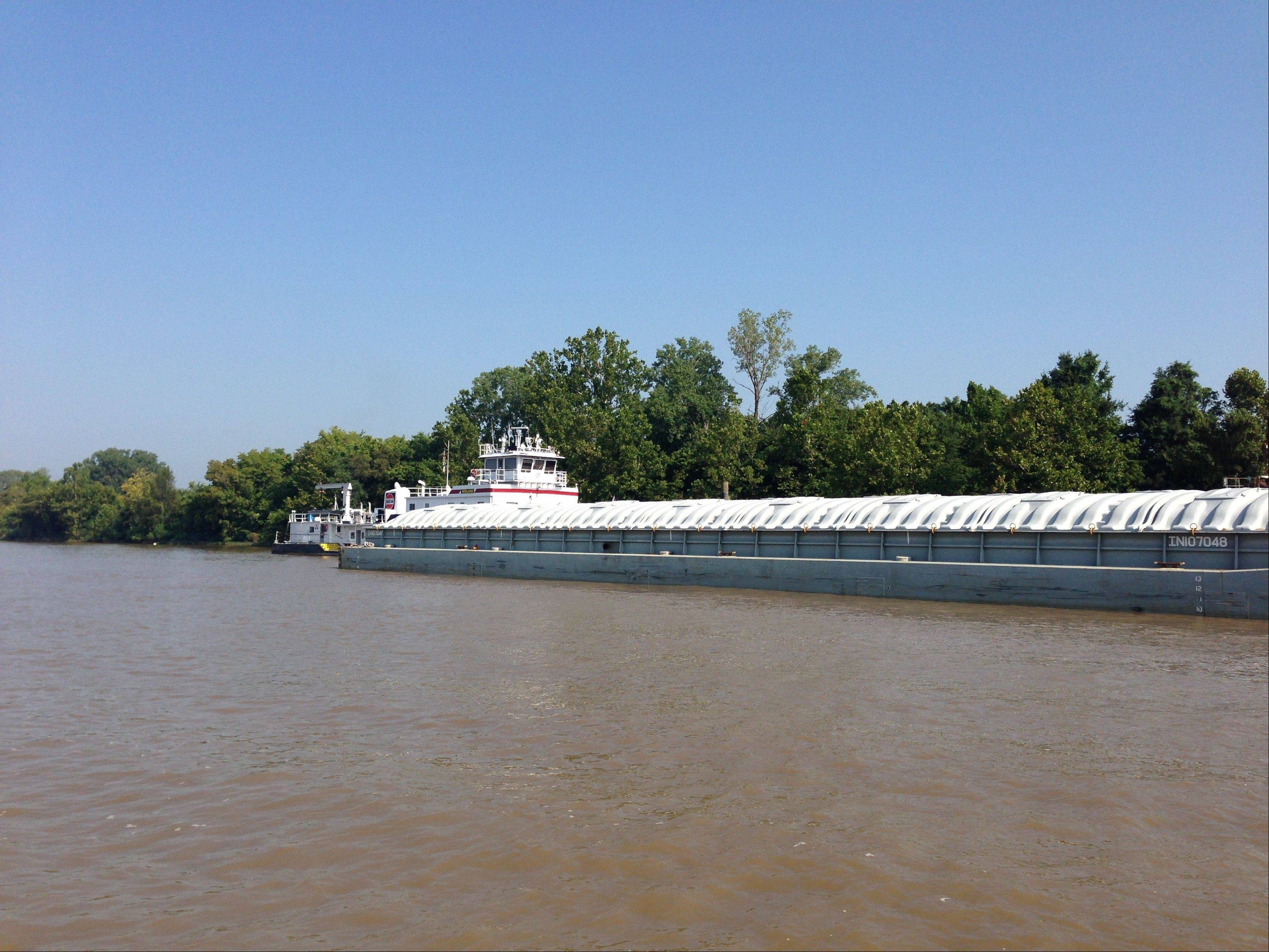 The MV Midland works Saturday on the Arkansas River, just below Little Rock, Ark.