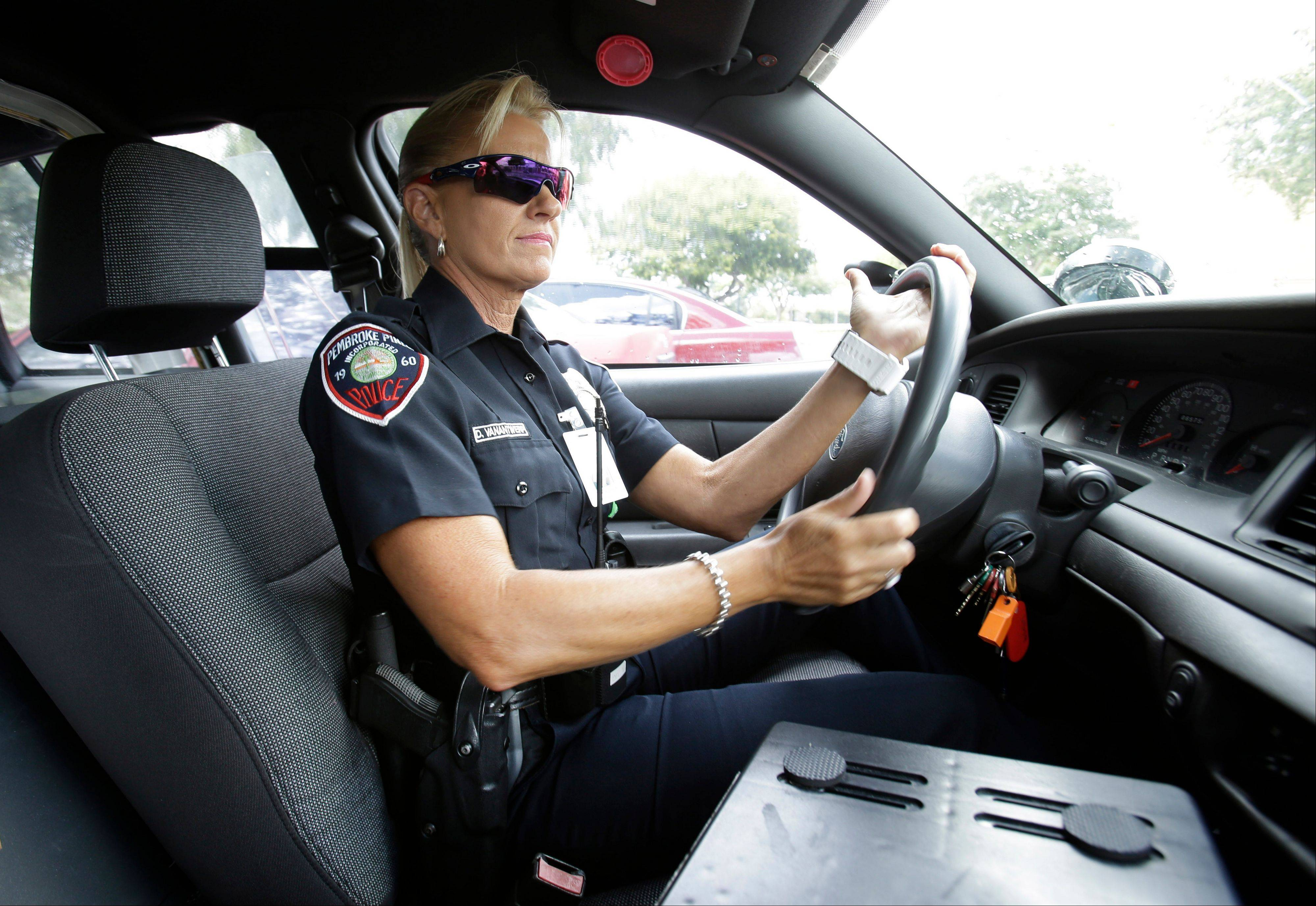 Dara Van Antwerp, the school resource officer at Panther Run Elementary School, drives her patrol car Thursday in Pembroke Pines, Fla., in the suburbs of Fort Lauderdale.