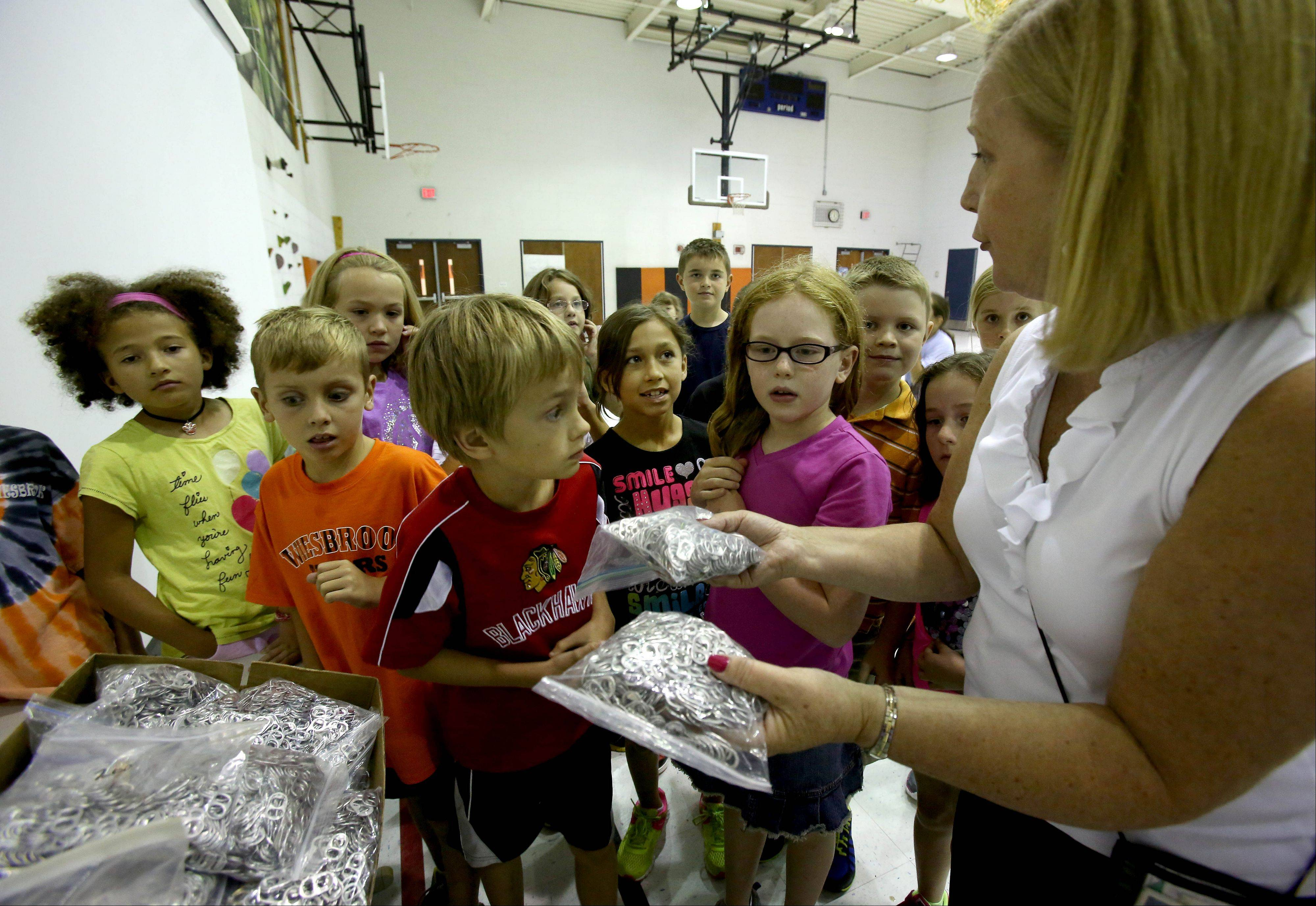 Elaine Cimino, a second-grade teacher at Wiesbrook Elementary School in Wheaton, and her students spent the past eight years collecting 1 million pop can tops to donate to Ronald McDonald House Charities.