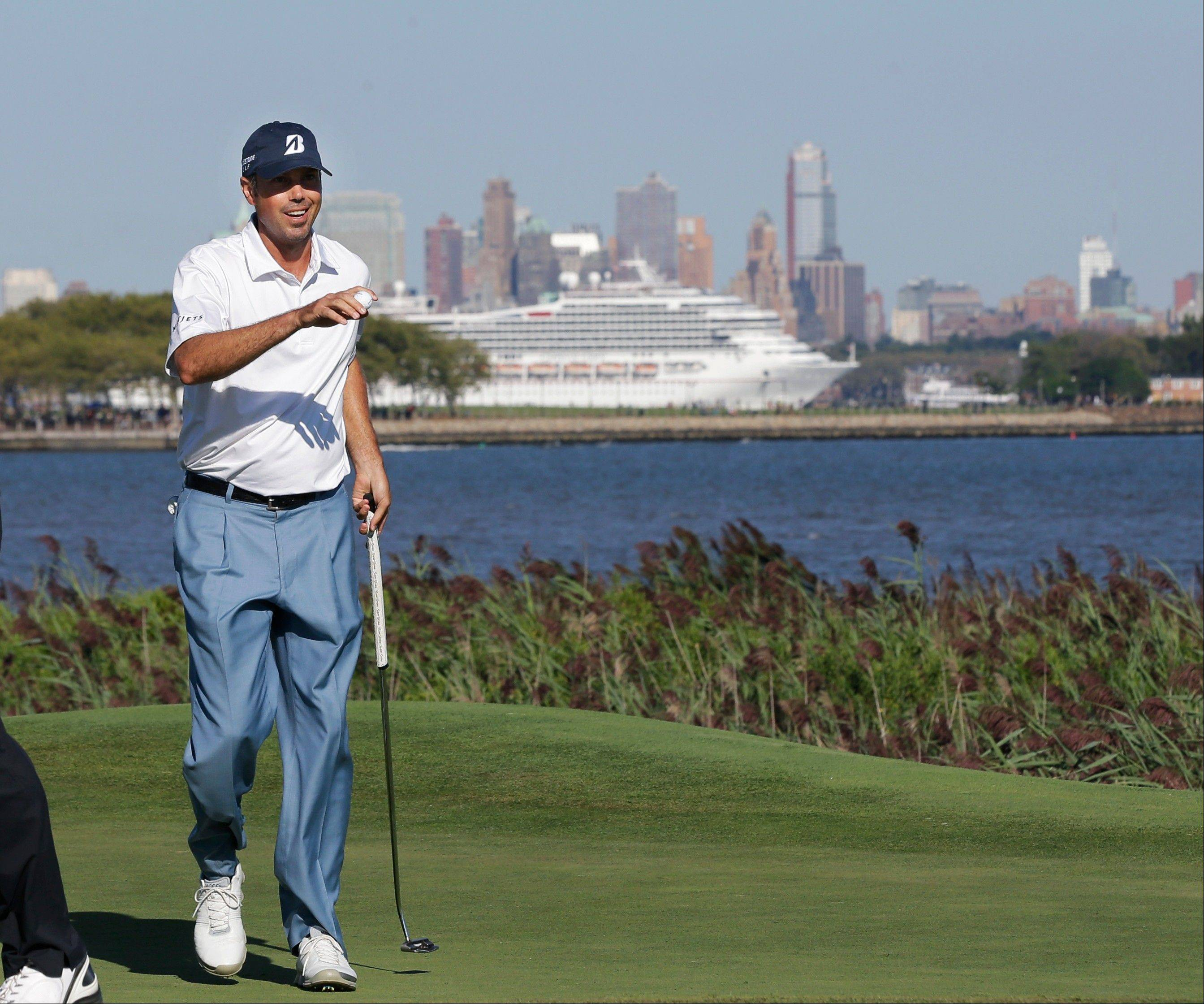 Matt Kuchar holds up his ball after making a birdie on 14th hole during the third round of The Barclays golf tournament Saturday, Aug. 24, 2013, in Jersey City, N.J.