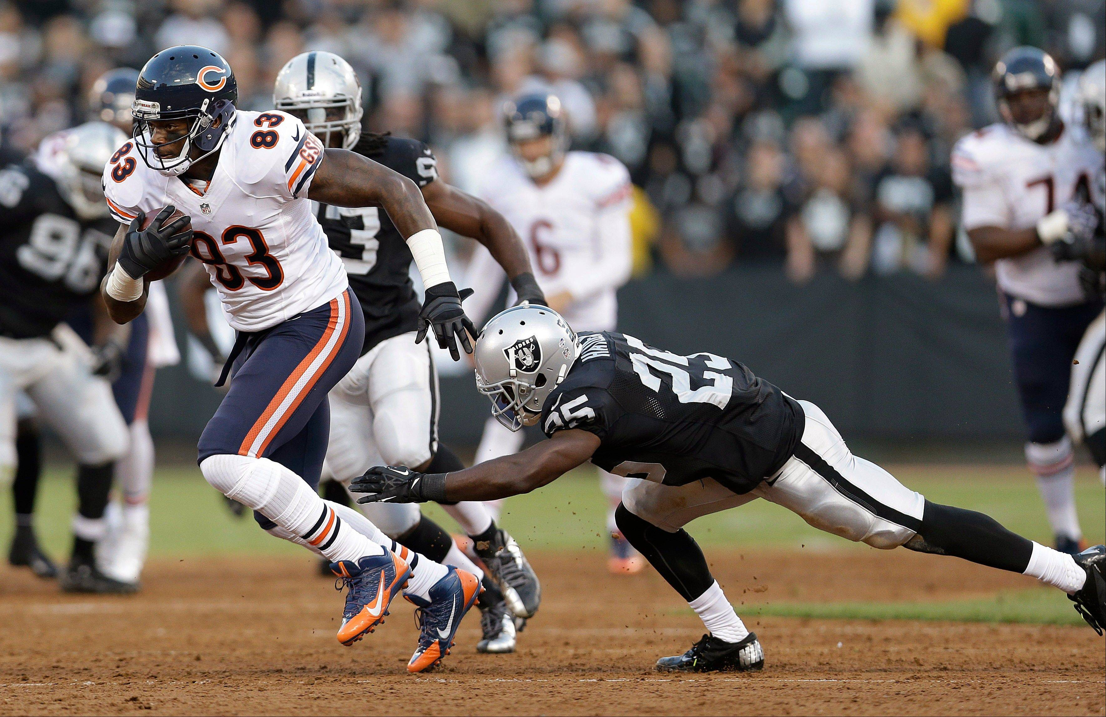 Chicago Bears tight end Martellus Bennett (83) runs past Oakland Raiders cornerback D.J. Hayden (25) during the first quarter.