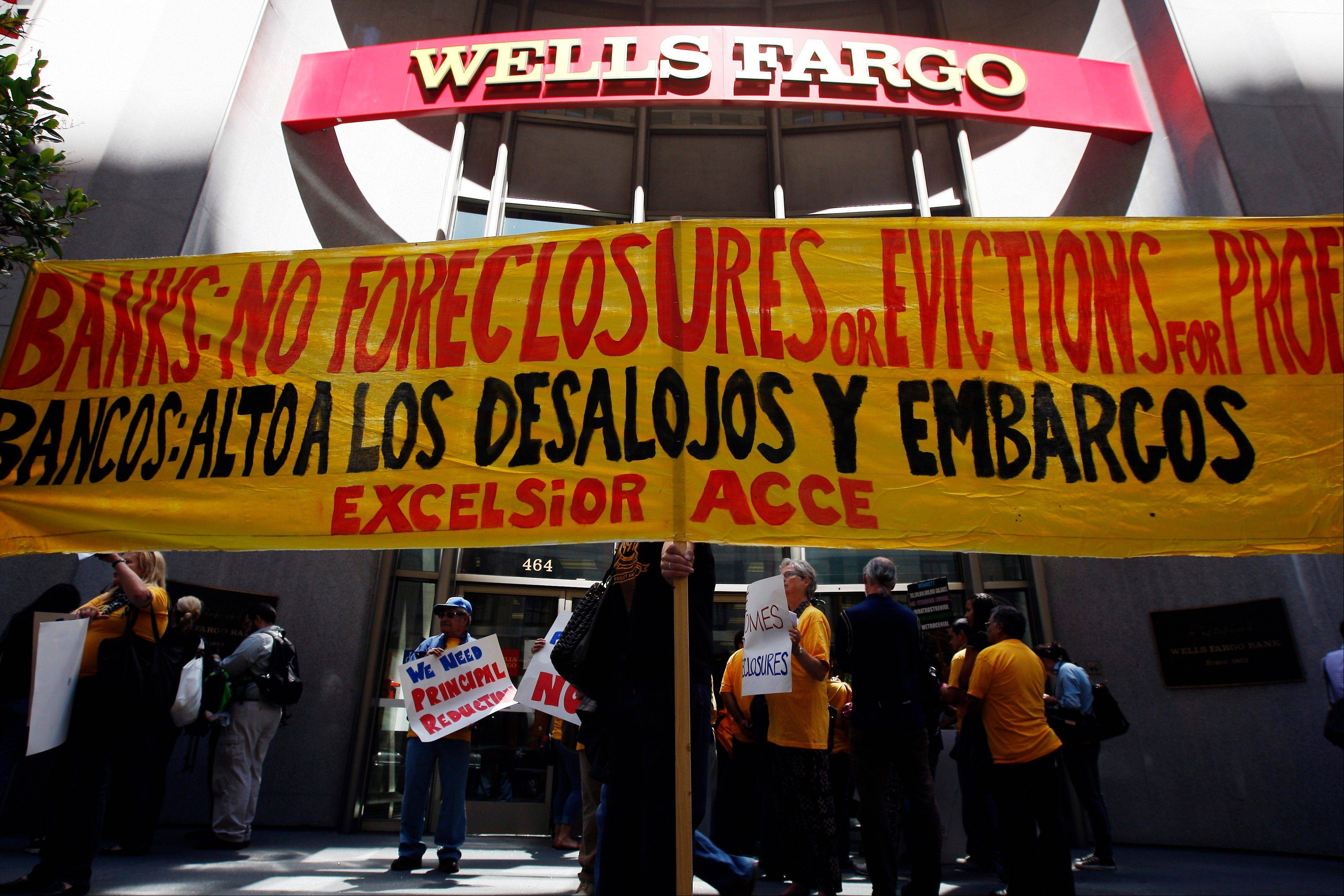 Protesters hold a banner outside of Wells Fargo headquarters in San Francisco earlier this month. The protesters wanted the bank to drop a first-in-the-nation plan by Richmond, Calif., to use the government�s constitutional power of eminent domain to �seize� hundreds of mortgages from Wells Fargo and other financial institutions.