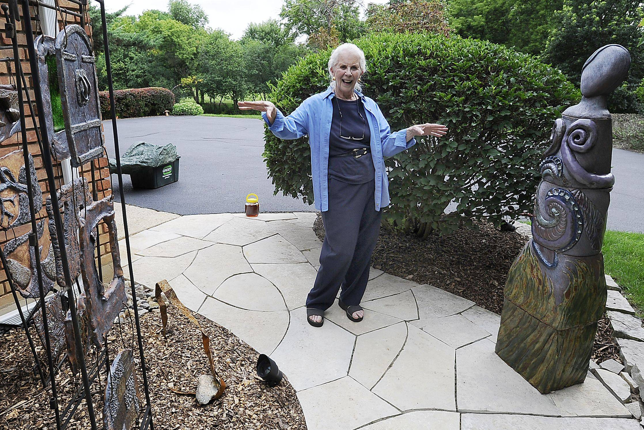 Lynn Rushing shows Mother Nature. She designed and laid the walk with the help of her late brother, Bill Fischer.