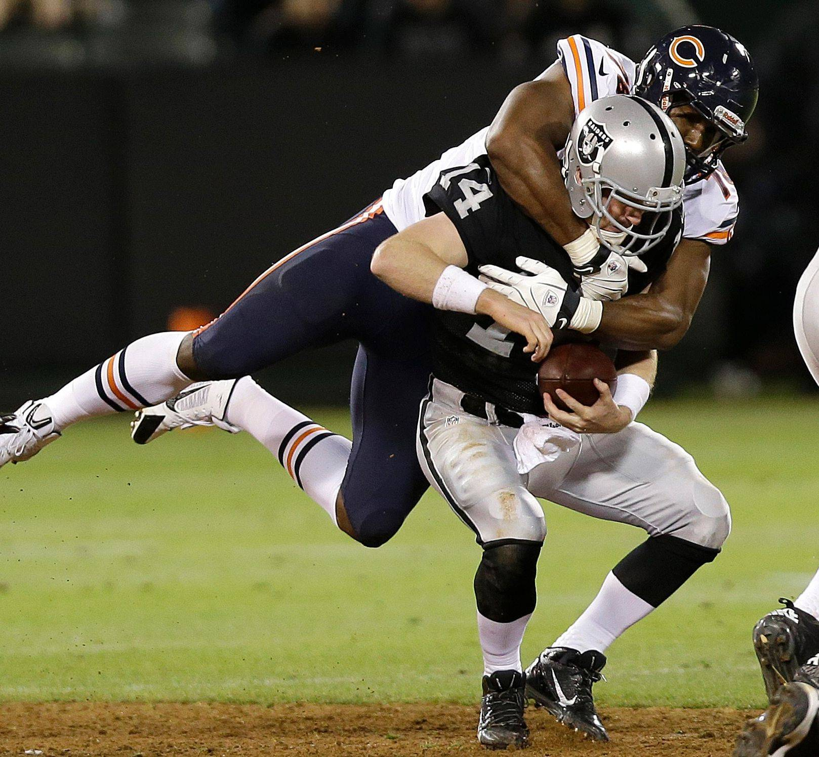 Cornelius Washington sacks Raiders quarterback Matthew McGloin during the fourth quarter of their preseason game Friday. Washington is a top contender to be kept as one of the team�s defensive ends.