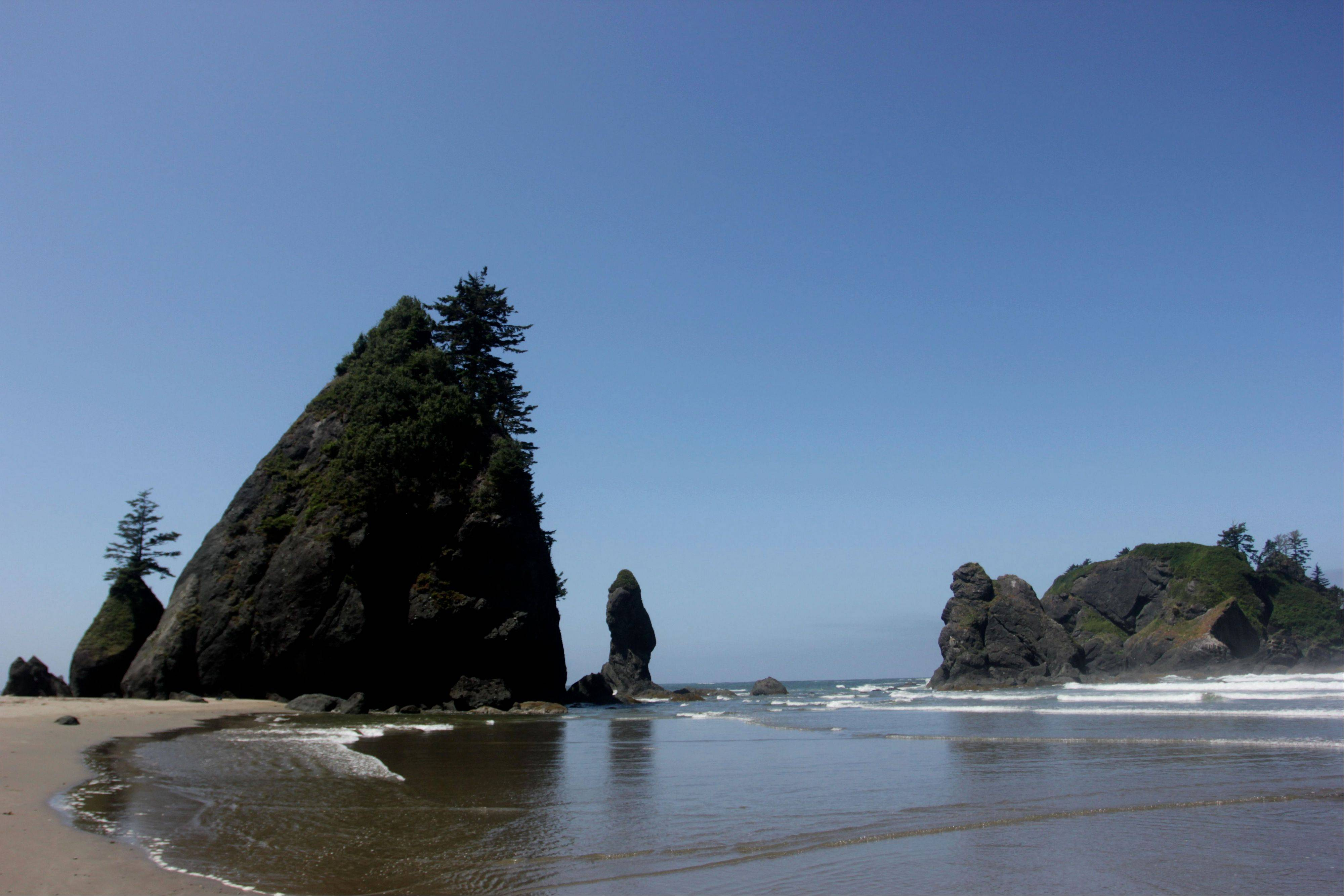 Sea rock formations known as the Point of Archers stand under the afternoon sun near Shi Shi Beach in Washington state's Olympic National Parks.