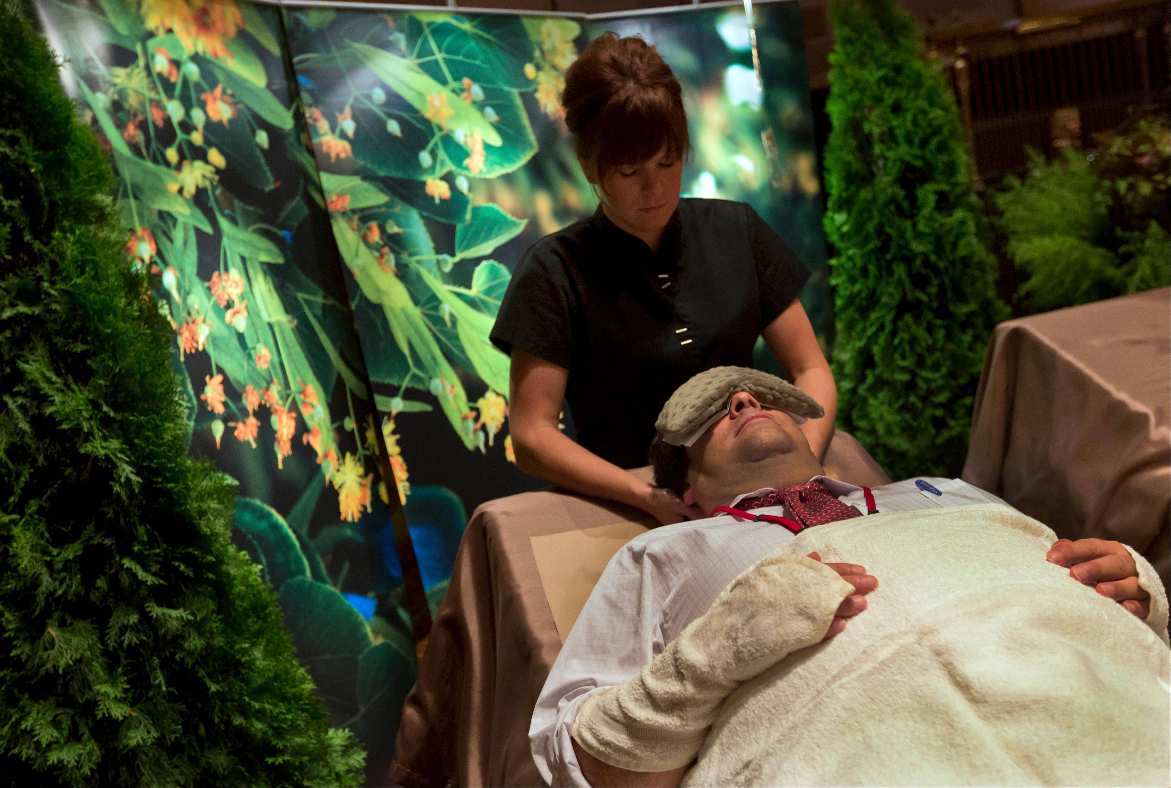 A man receives a Trilogy of Linden treatment from Brooke Hess at the Aspira Spa at the Osthoff Resort in Elkhart Lake, Wis.