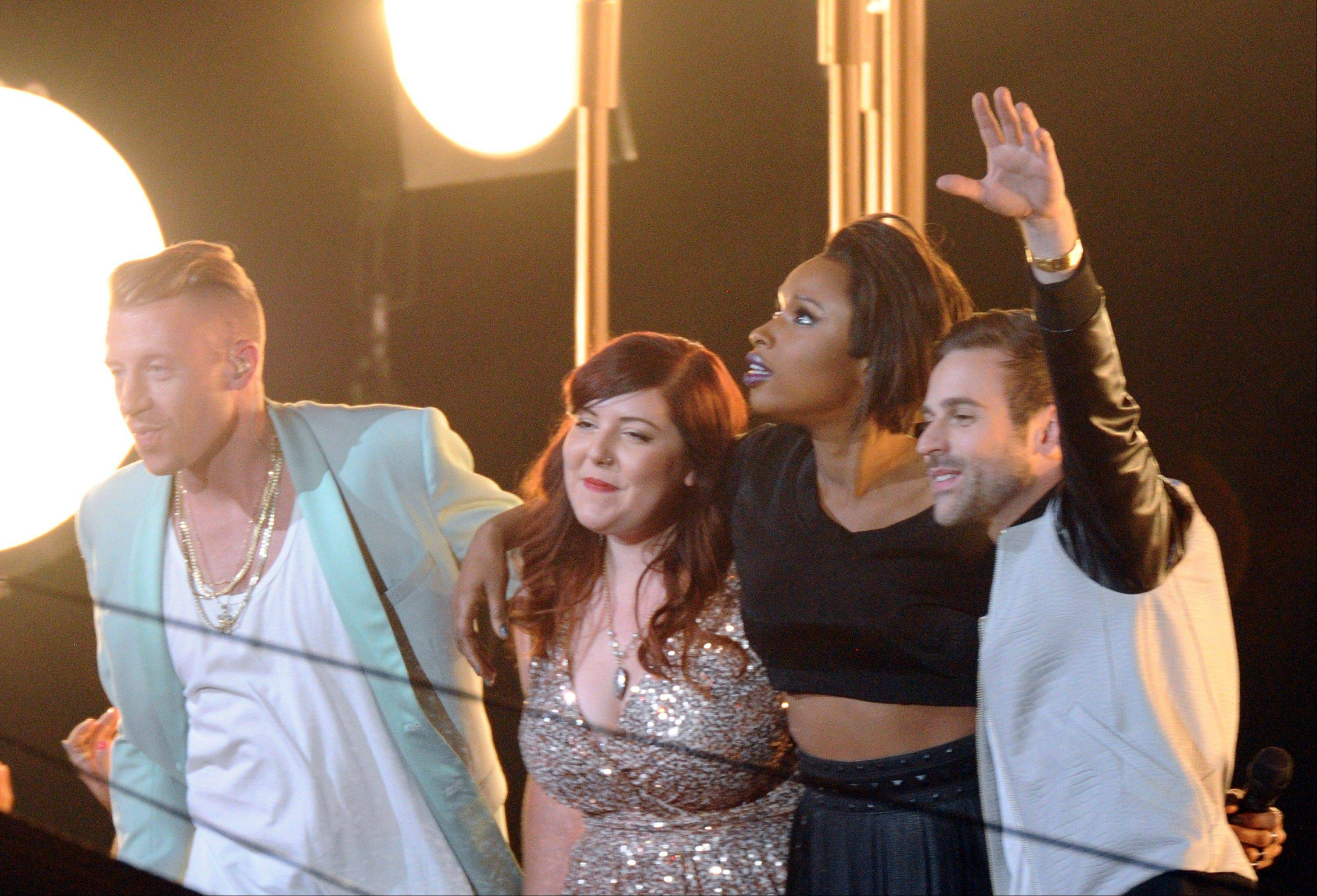 Macklemore, from left, Mary Lambert, Jennifer Hudson and Ryan Lewis perform at the MTV Video Music Awards on Sunday, Aug. 25, 2013, at the Barclays Center in the Brooklyn borough of New York.