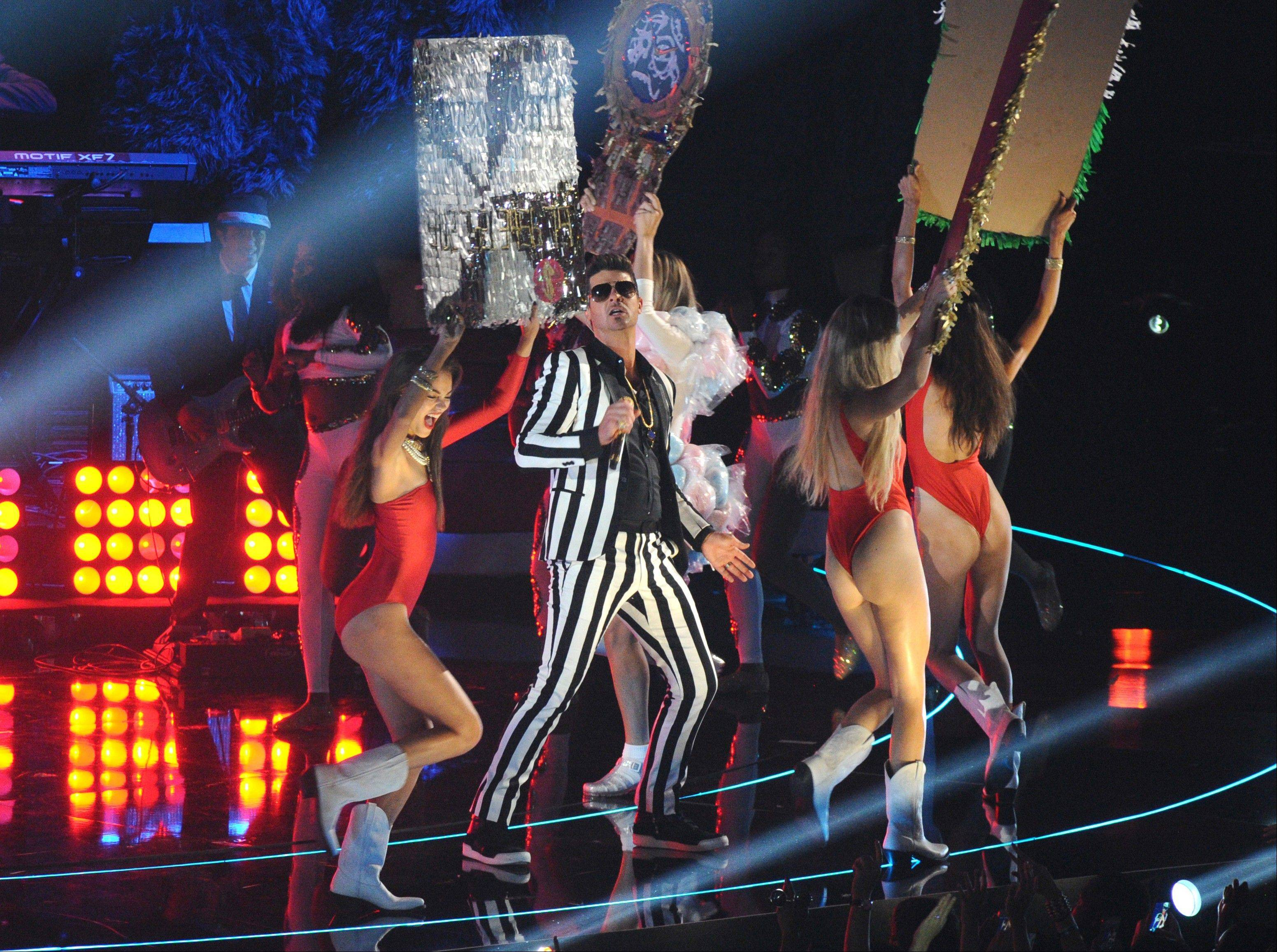 Robin Thicke performs at the MTV Video Music Awards on Sunday, Aug. 25, 2013, at the Barclays Center in the Brooklyn borough of New York.
