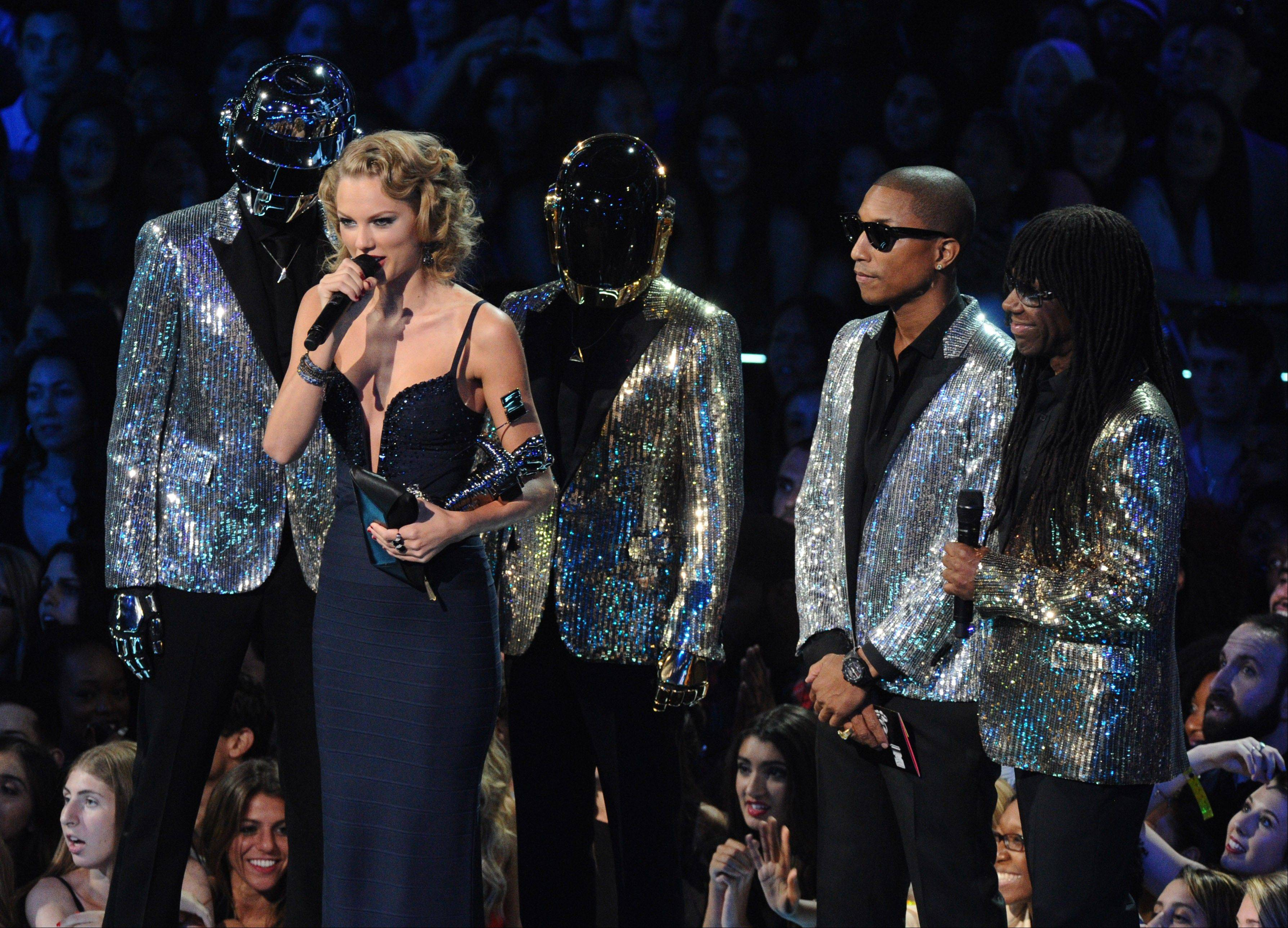 "Taylor Swift accepts the award for best female video for ""I Knew You Were Trouble"" from Pharrell Williams and Daft Punk at the MTV Video Music Awards on Sunday, Aug. 25, 2013, at the Barclays Center in the Brooklyn borough of New York."