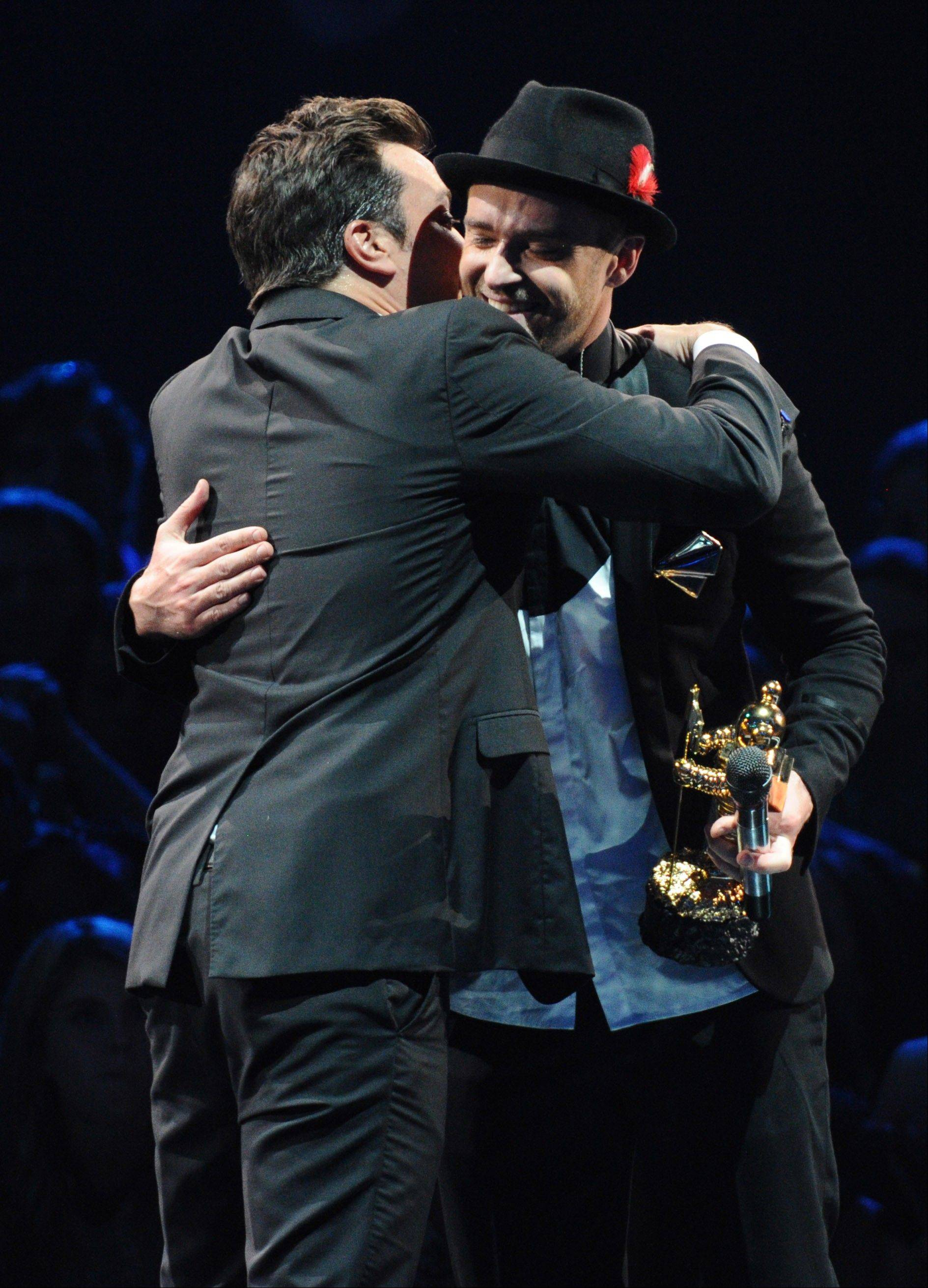 Justin Timberlake accepts the video vanguard award from Jimmy Fallon, left, at the MTV Video Music Awards on Sunday, Aug. 25, 2013, at the Barclays Center in the Brooklyn borough of New York.