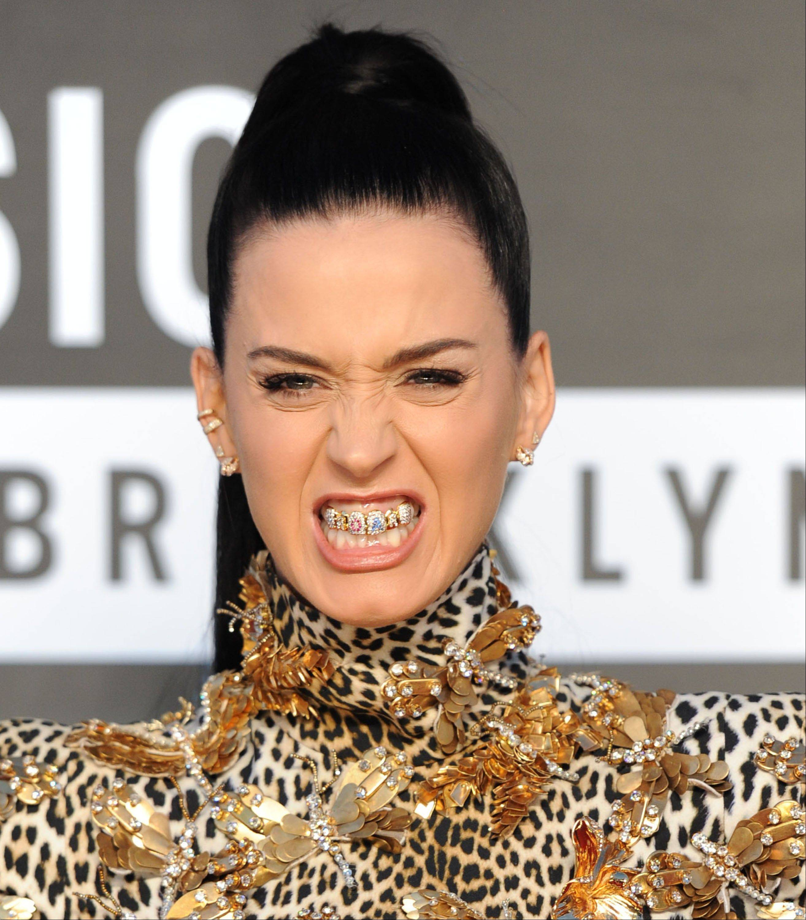 "Katy Perry wears a grill that says ""ROAR"" as she arrives Sunday at the MTV Video Music Awards at the Barclays Center in Brooklyn."