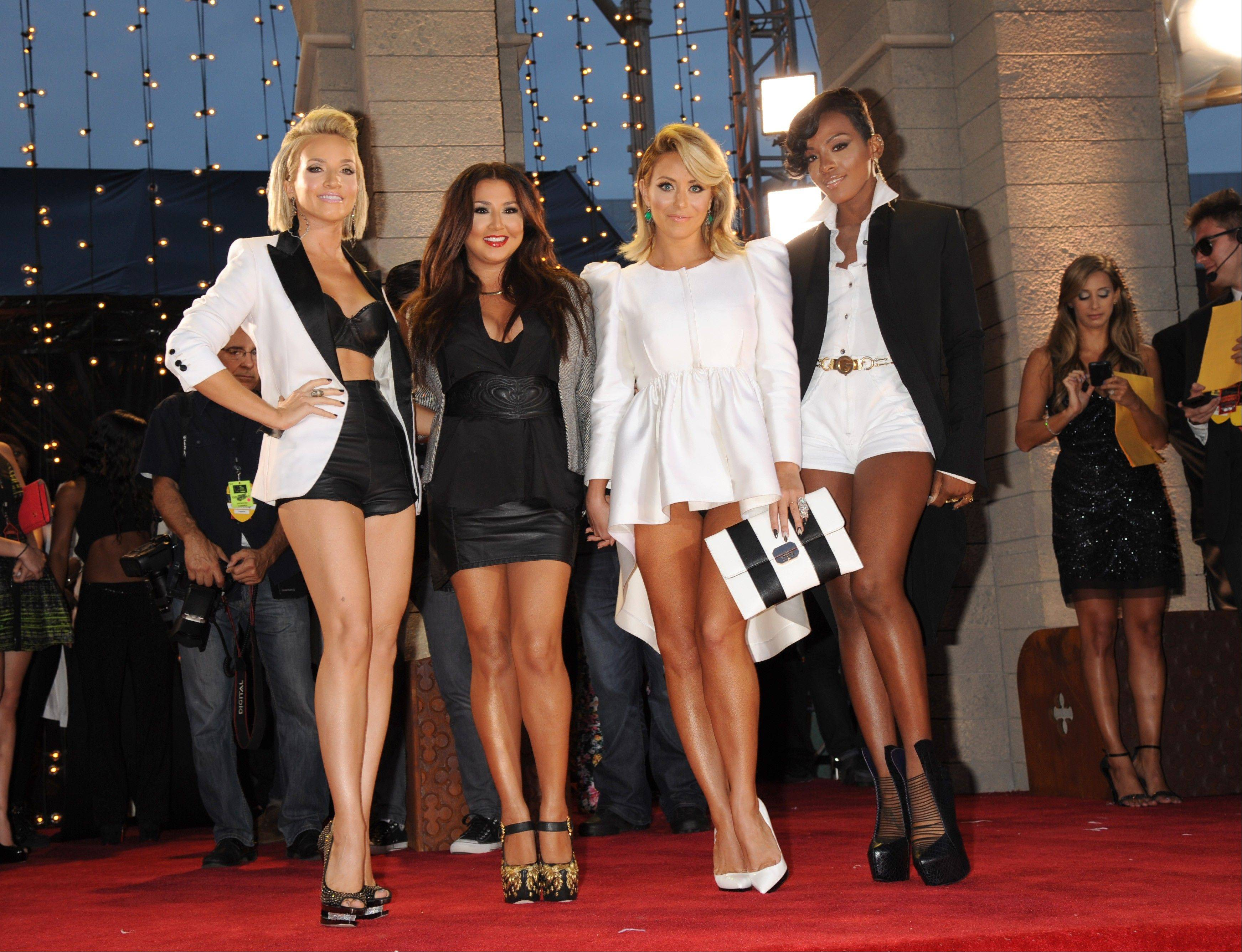Members of of Danity Kane, from left, Shannon Bex, Andrea Fimbres, Aubrey O'Day and Dawn Richards arrive at the MTV Video Music Awards on Sunday, Aug. 25, 2013, at the Barclays Center in the Brooklyn borough of New York.